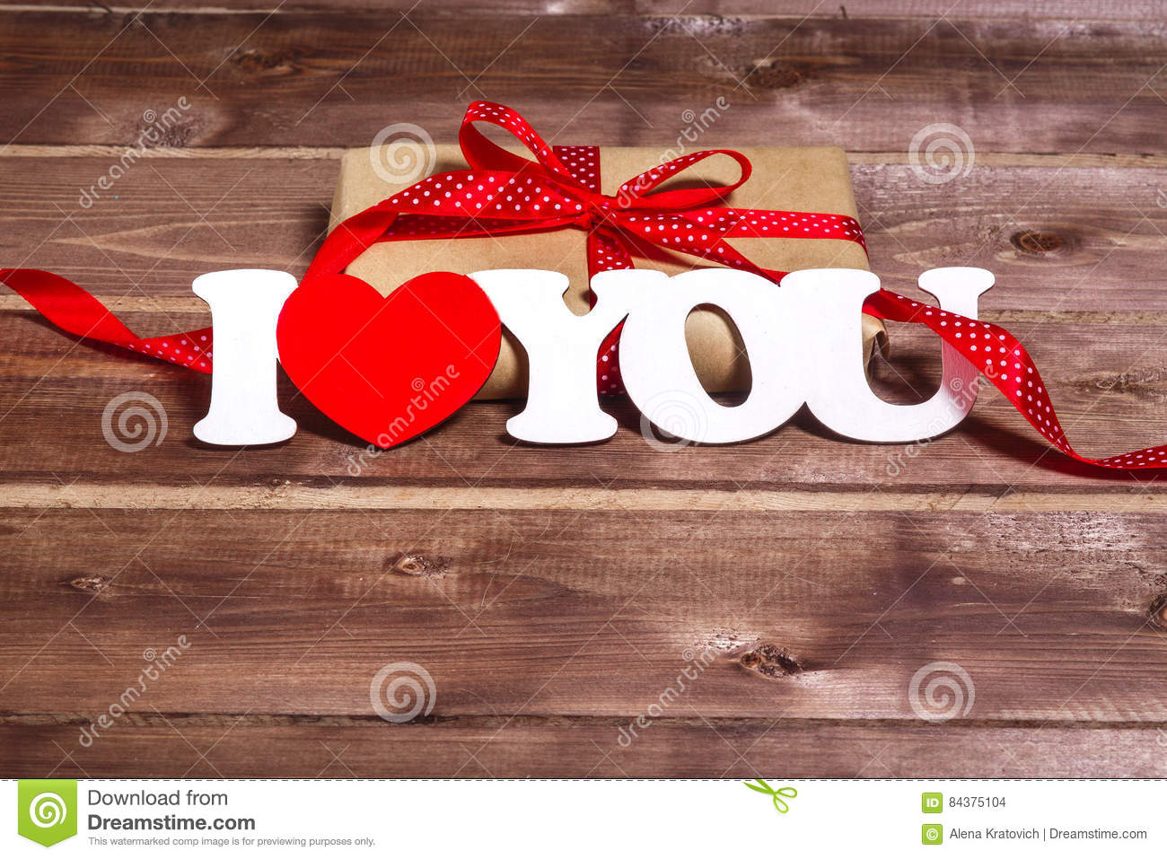 Gift And The Words `I Love You` On A Wooden Background . Valentines ...