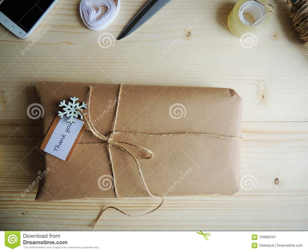 gift wrapping parcel on wooden background small business stock