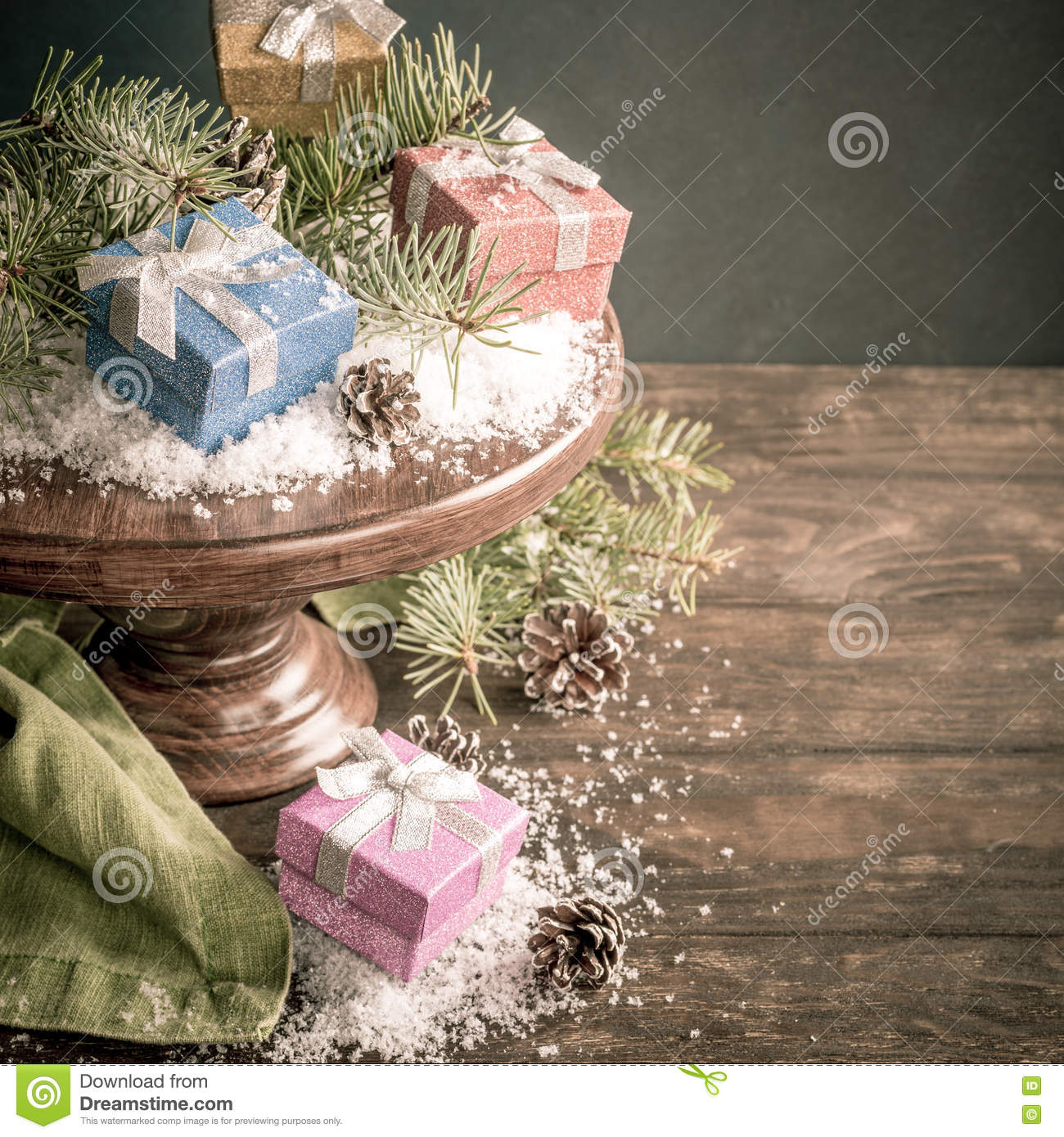 Gifts With Christmas Decoration On Wooden Cake Stand Stock Photo