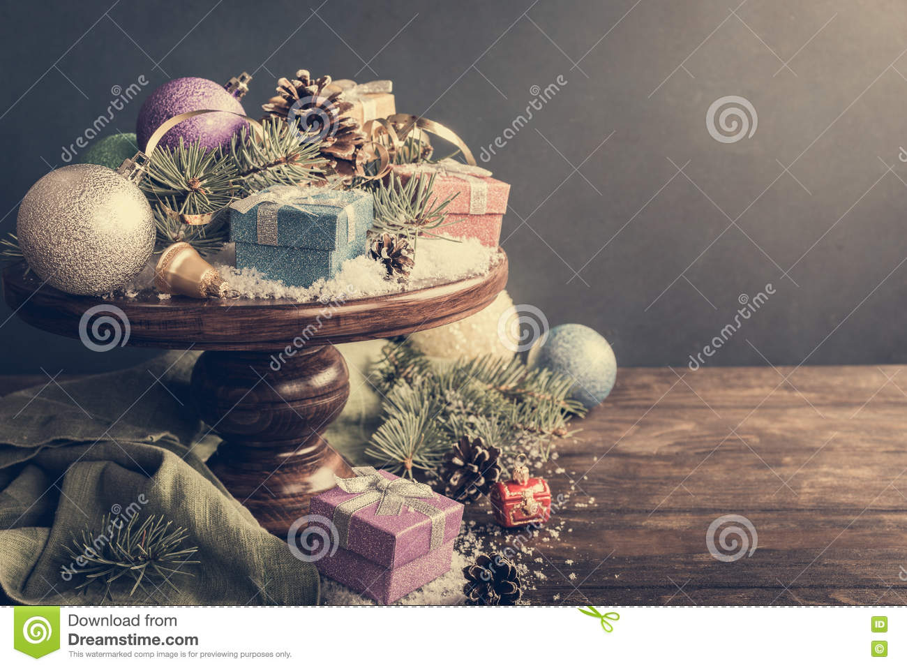 Gifts With Christmas Decoration On Wooden Cake Stand Stock Image