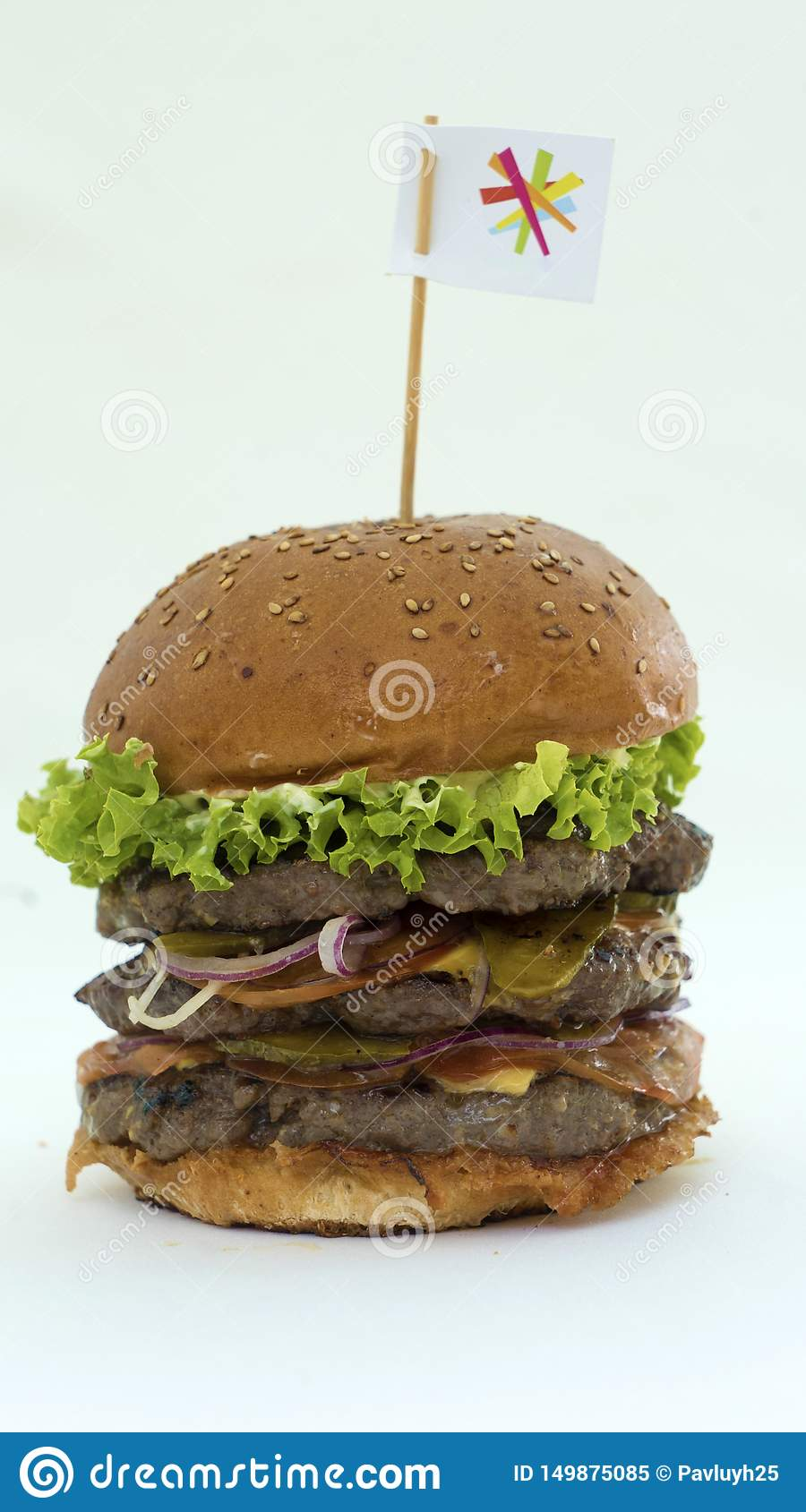Juicy burger with meat and fresh vegetables on a white background, cooked with your own hands