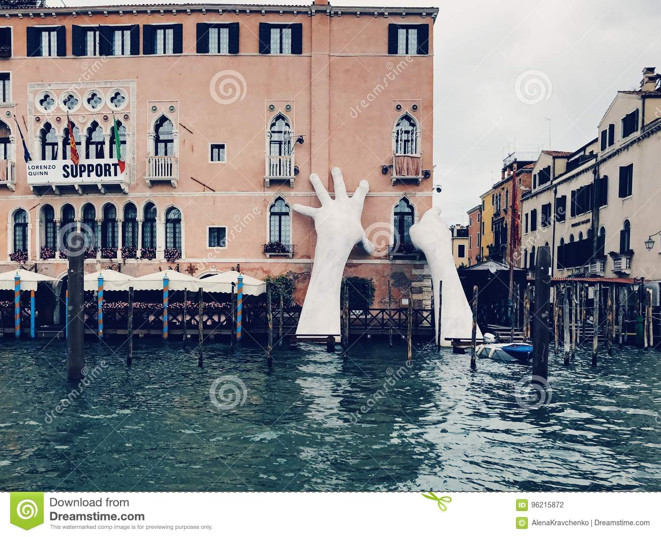 Gigantic hands rising from water to support the Ca' Sagredo Hotel, Venice