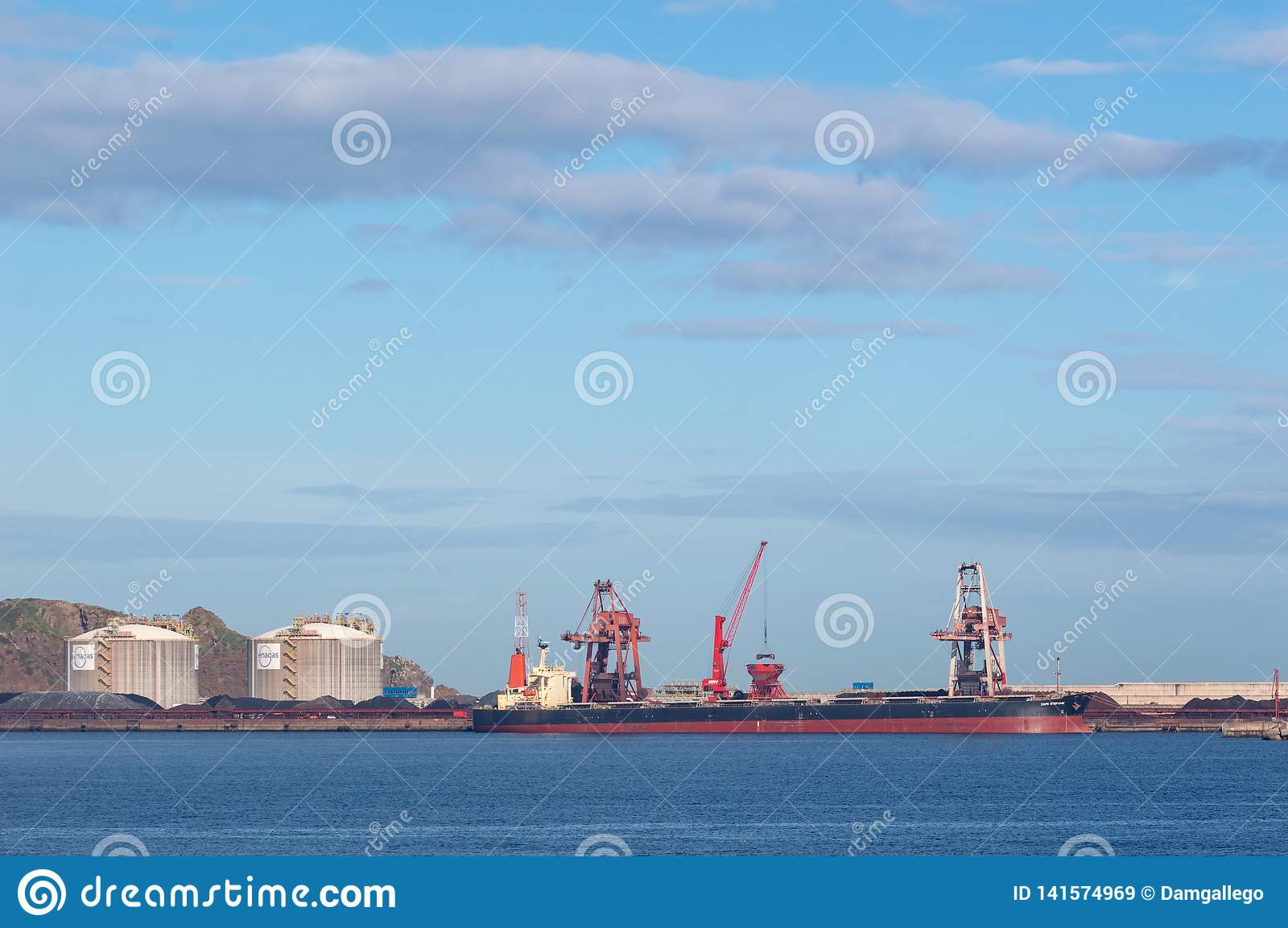 4a41eebe18143f Coal Cargo Ship Moored In Port With Lifting Cargo Cranes