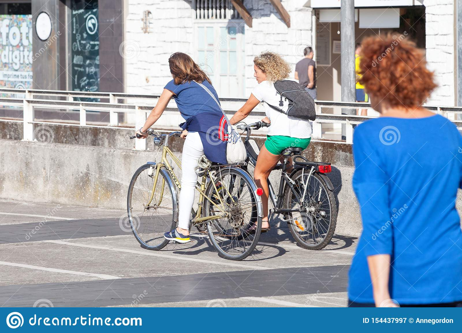 Young couple riding bicycles in the city
