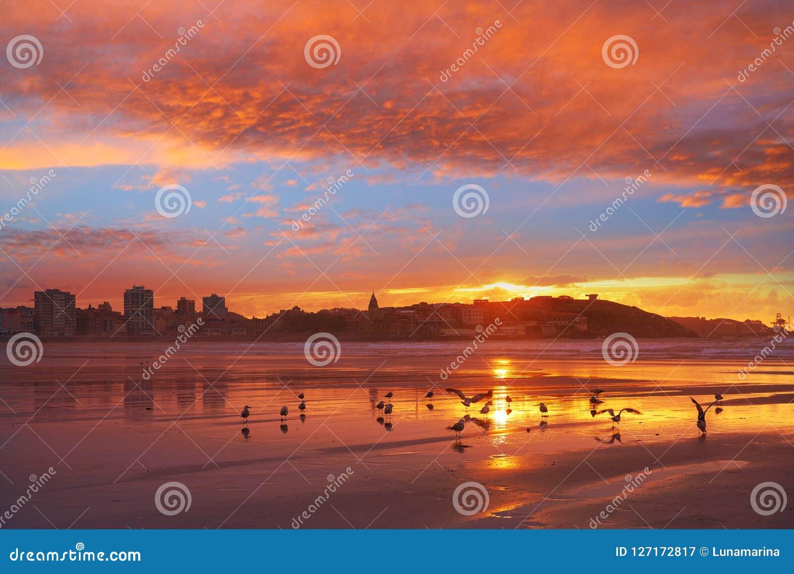 Gijon skyline sunset in San Lorenzo beach Asturias