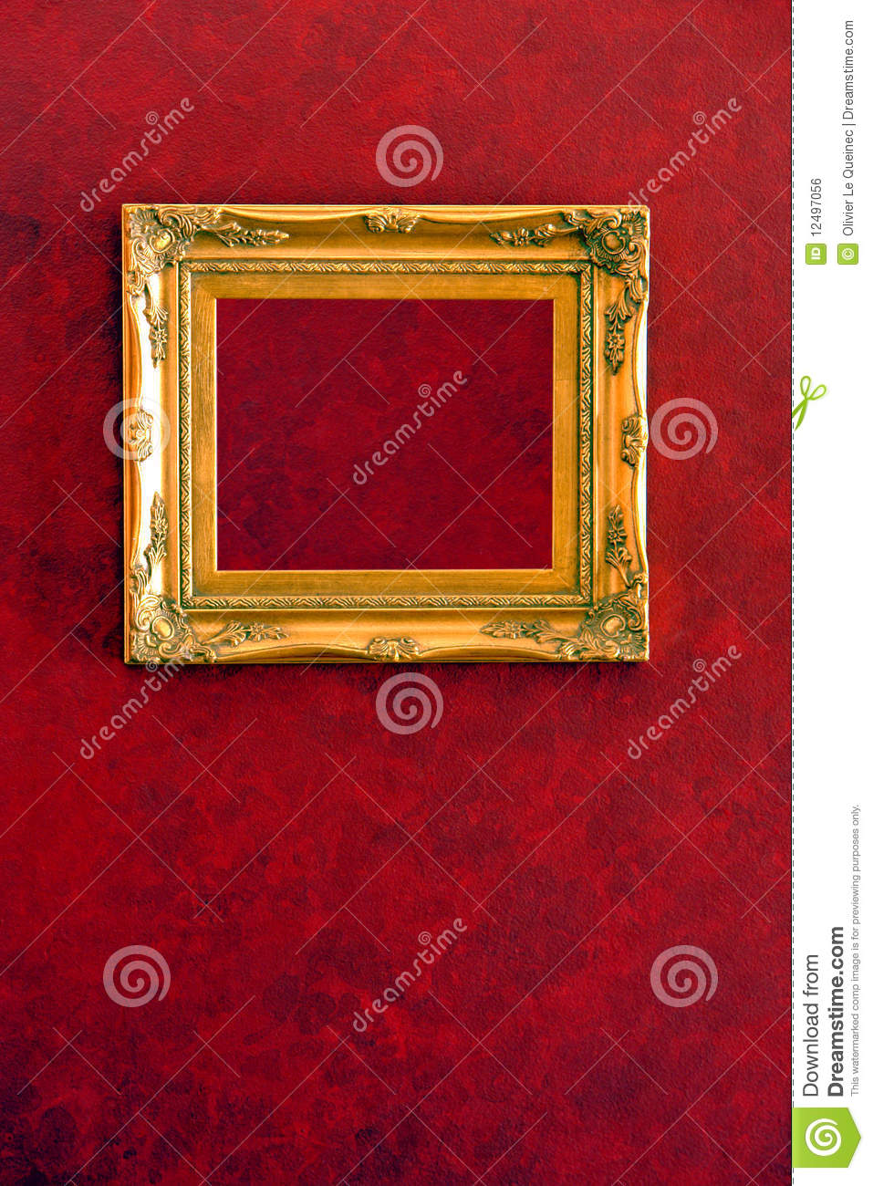 Gilded Gold Frame On Red Wall Background Stock Photo
