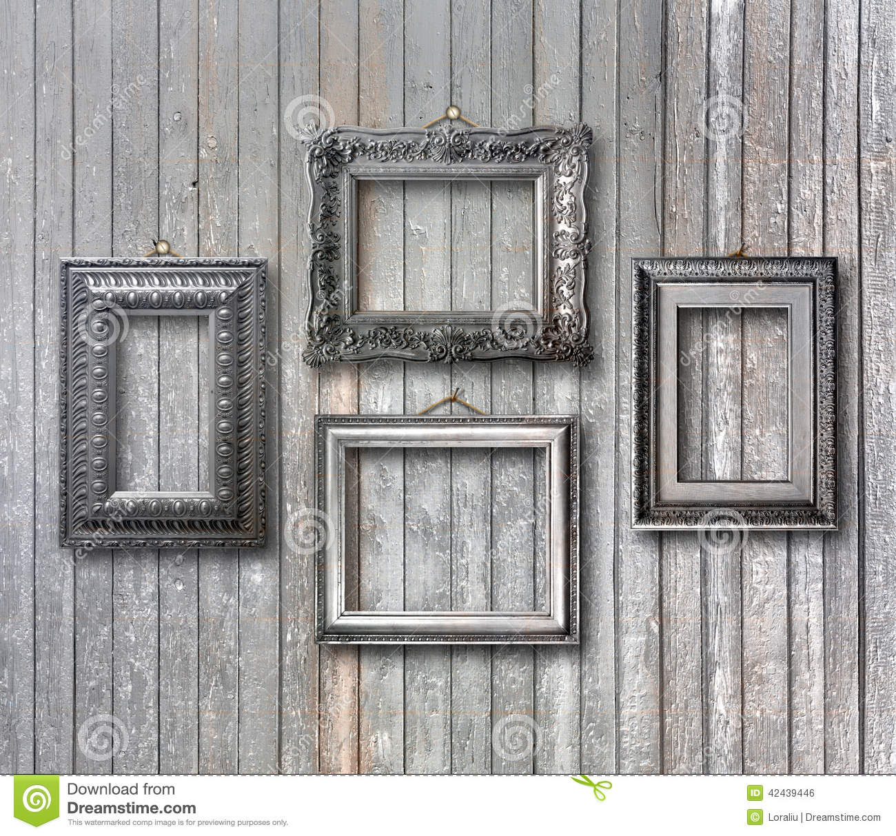Wooden Wall Framing : Gilded wooden frames for pictures on rusty wall stock