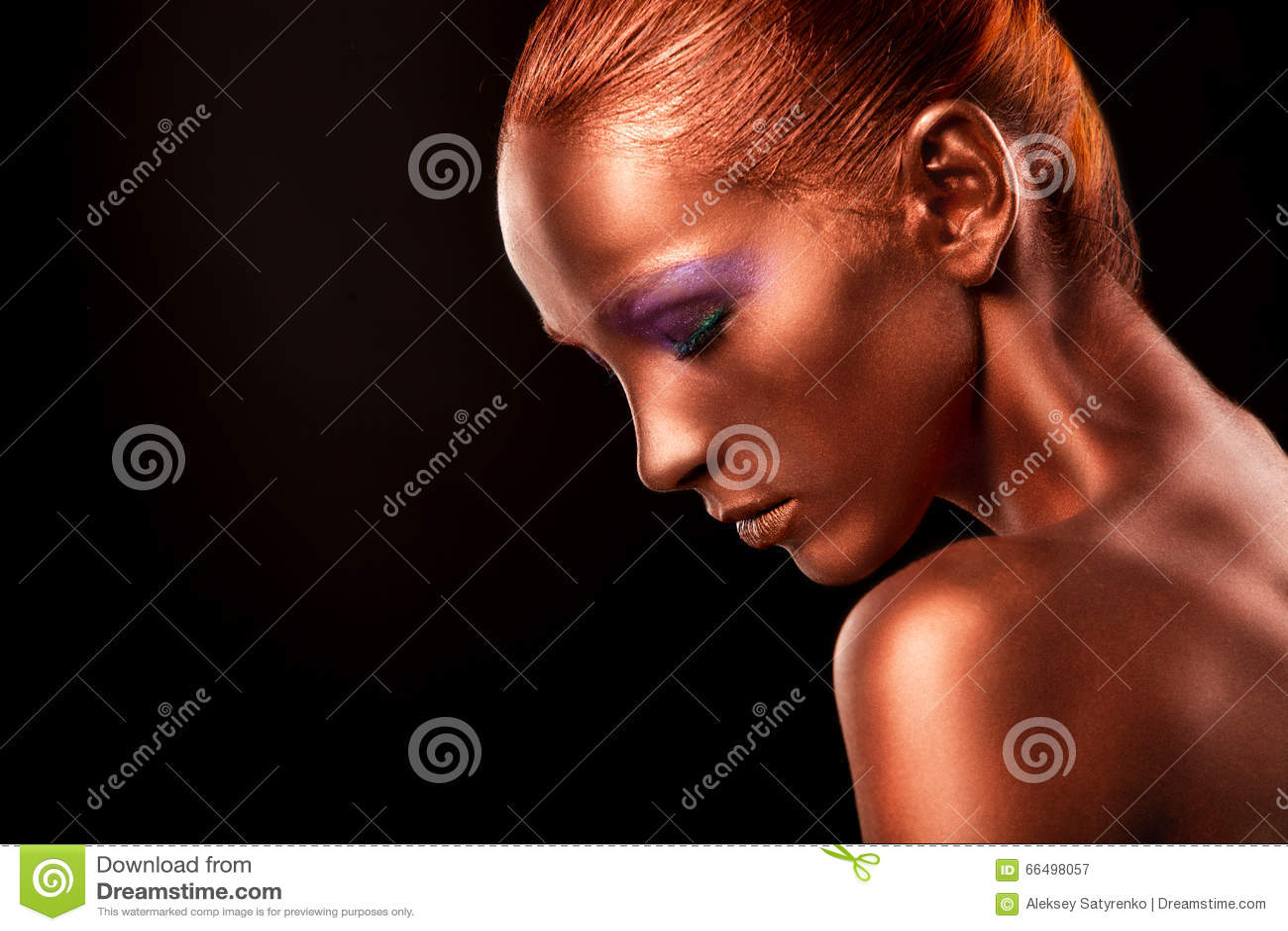 Gilt. Golden Woman s Face Closeup. Futuristic Gilded Make-up. Painted Skin bronze.