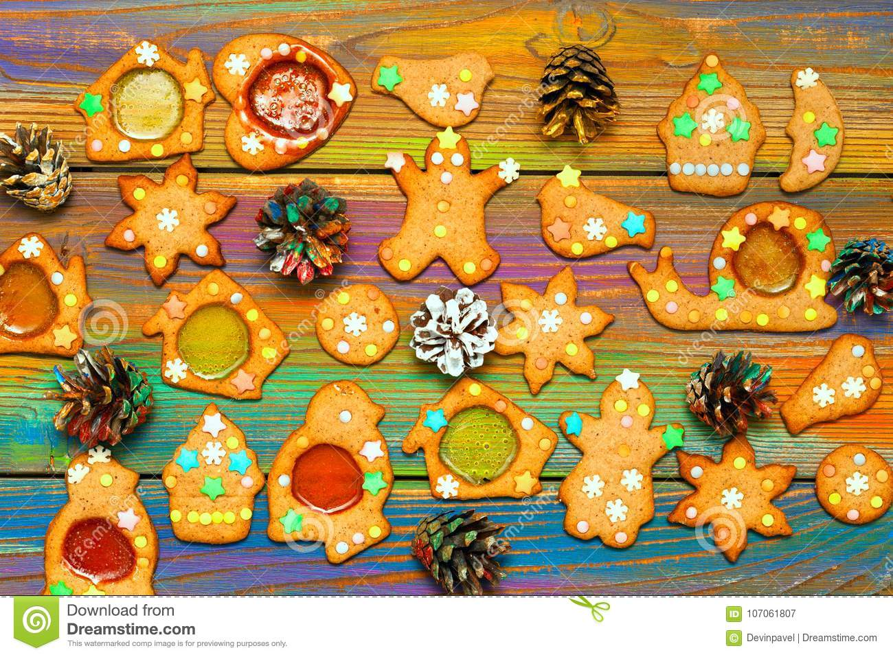 Ginger biscuits and decorative Christmas cones. Christmas festive bright background. Food and sweets