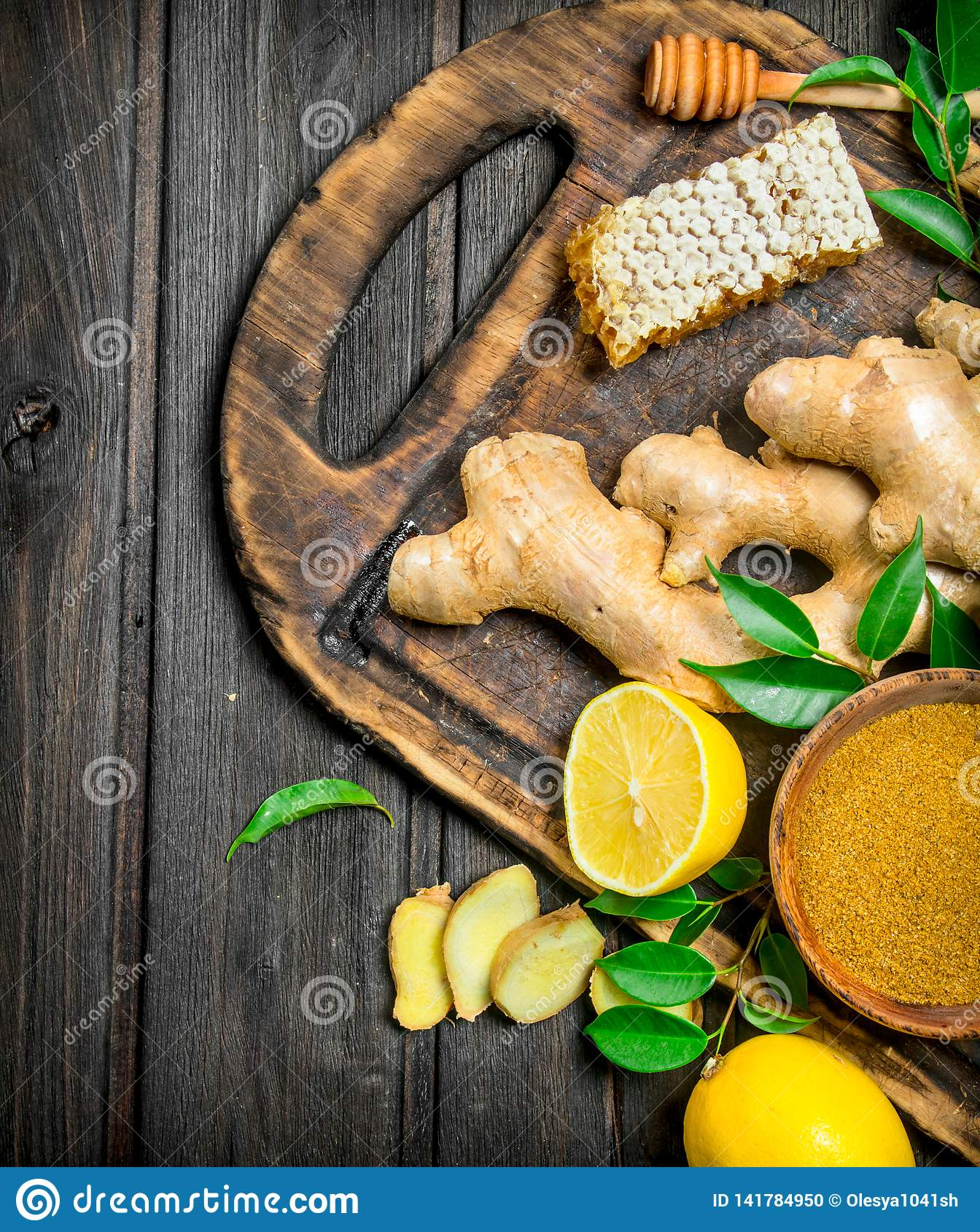 Ginger with lemon and honey on the cutting Board