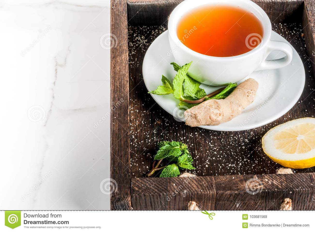A Marble In A Cup Of Honey : Ginger tea with lemon mint and honey stock image