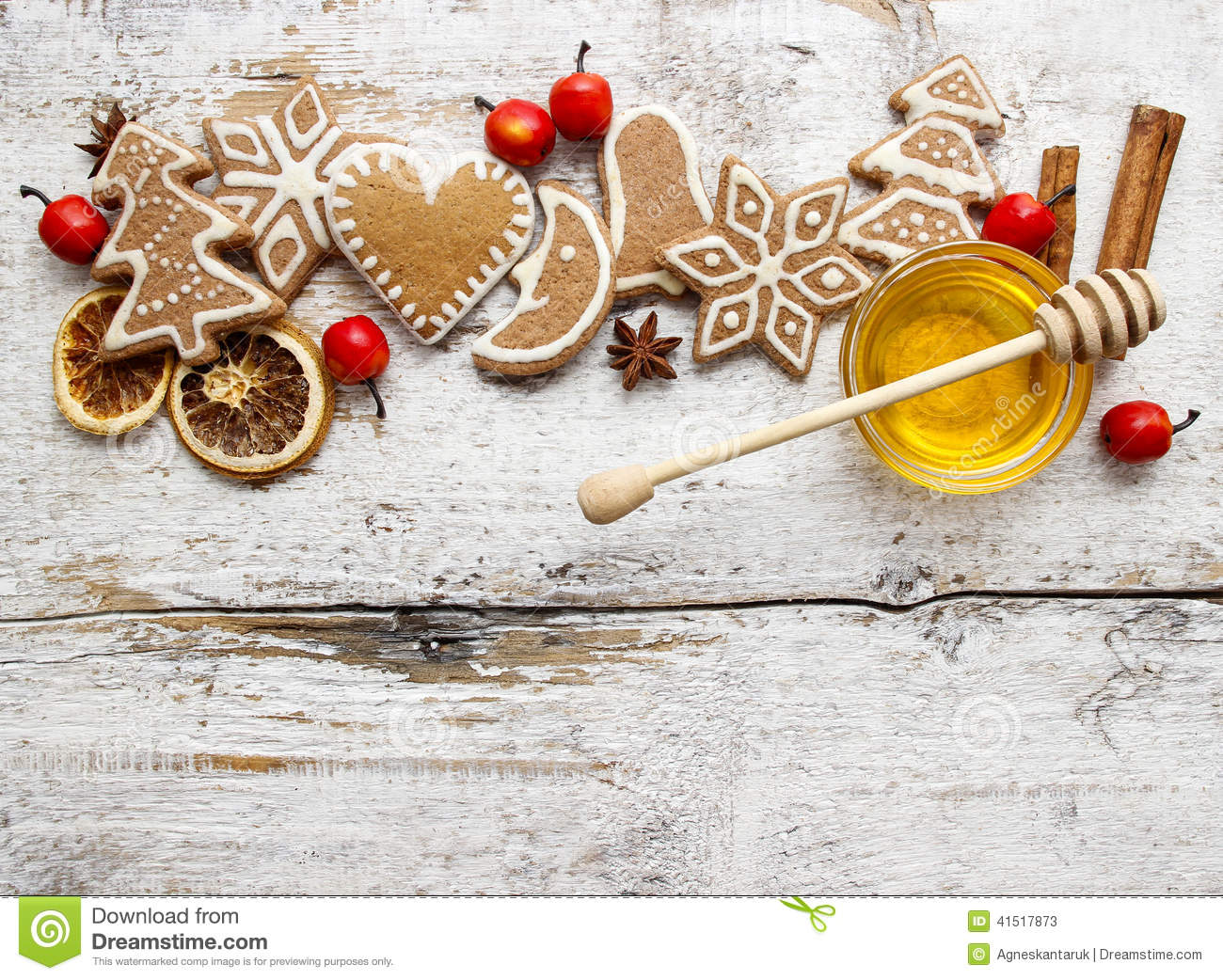 Gingerbread Christmas Cookies And Bowl Of Honey On Wooden