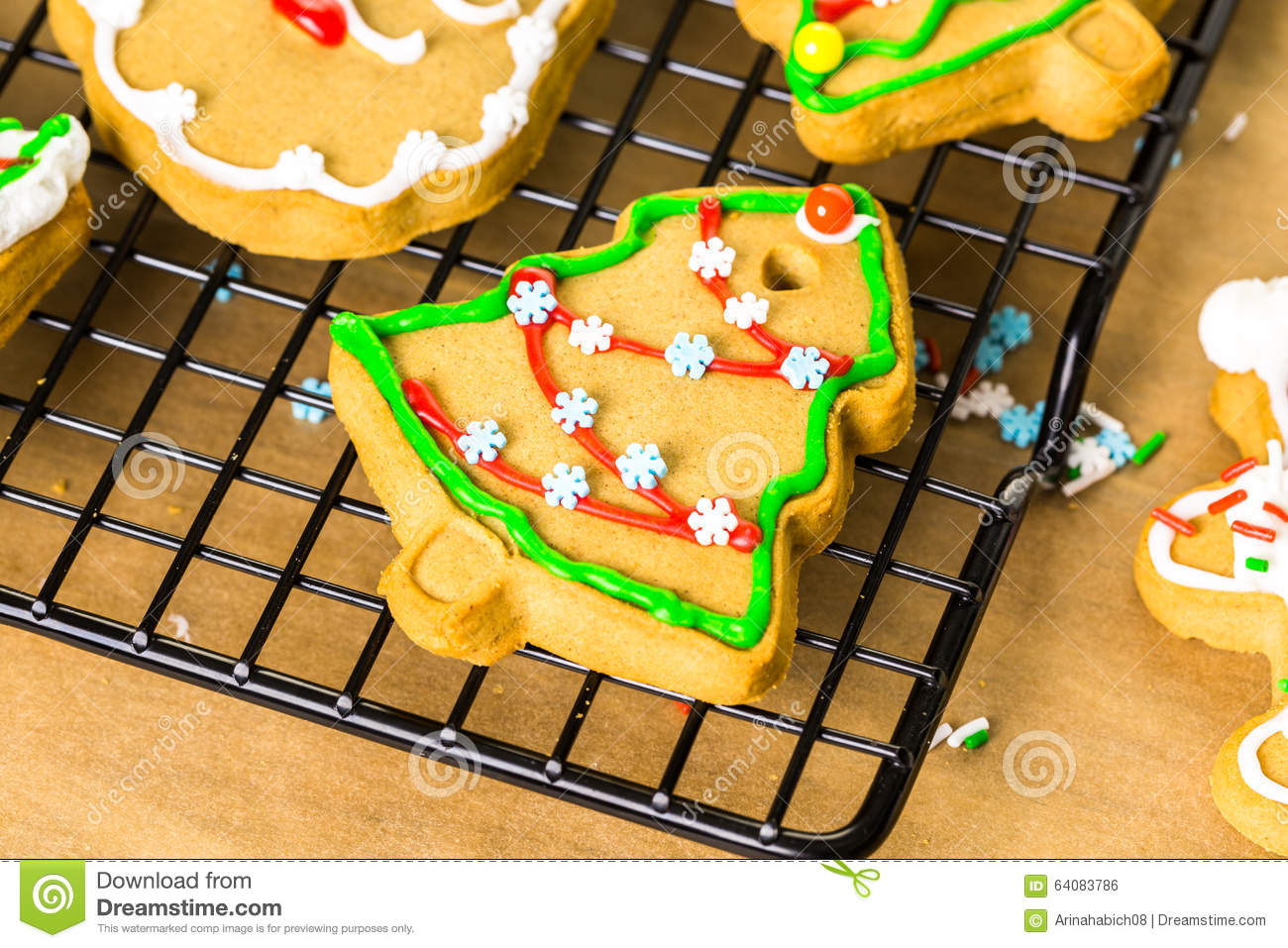 Decorating gingerbread cookies with royal icing and colorful candies.
