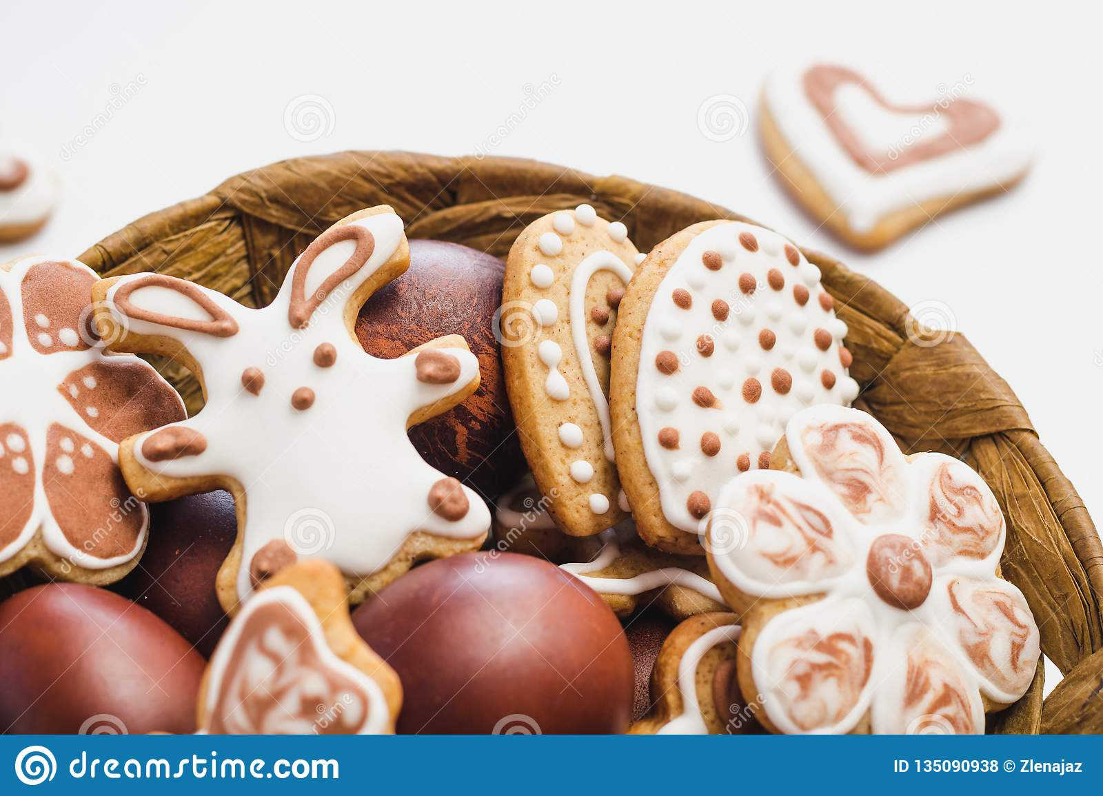 Gingerbread cookies in the shape of an Easter bunny, flowers and hearts, covered with white and chocolate icing-sugar, and easter