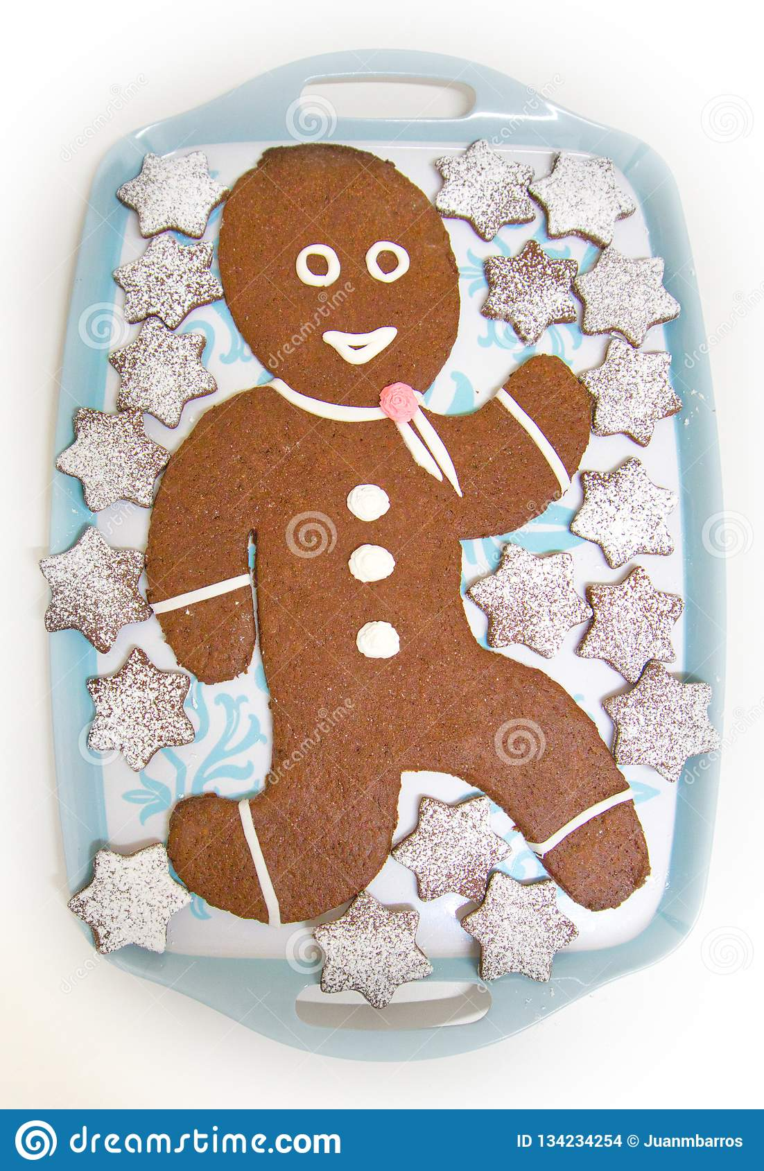 Gingerbread doll with chocolate and stars