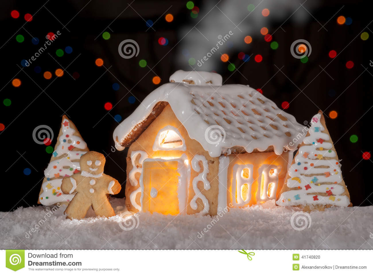 Gingerbread House With Gingerbread Man And Christmas Trees