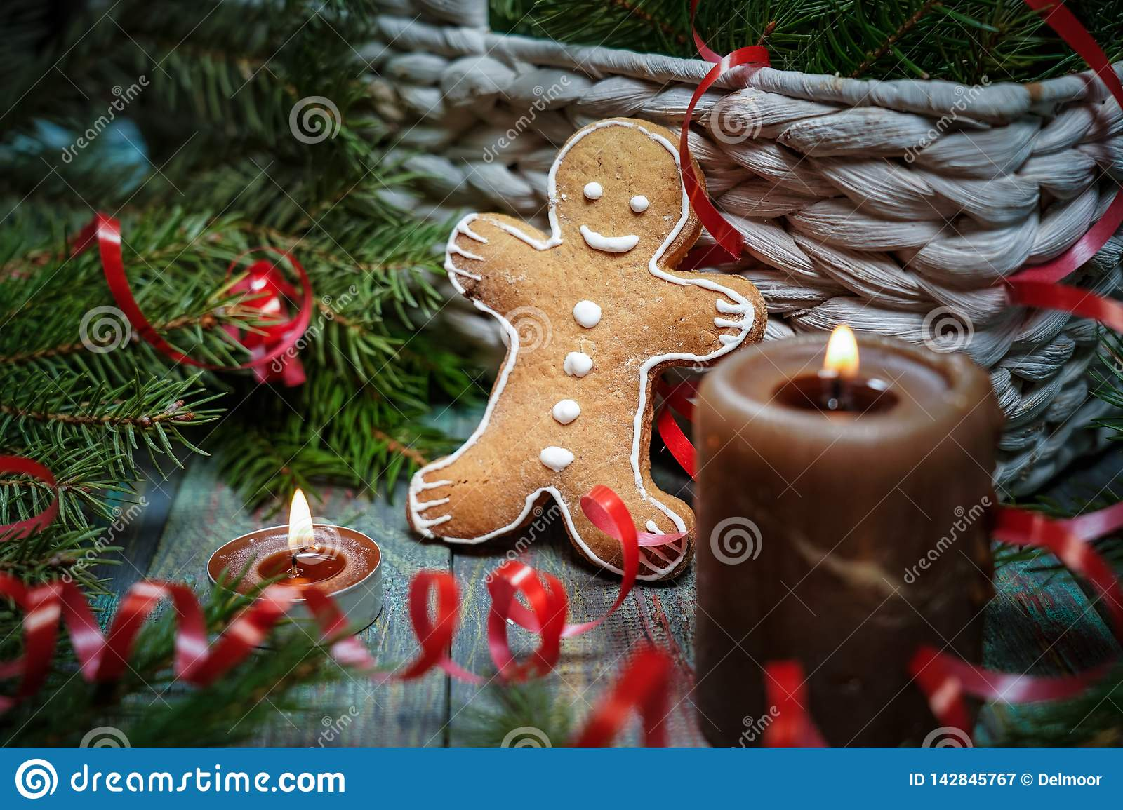 A gingerbread man with Christmas decorations and lots of fir branches