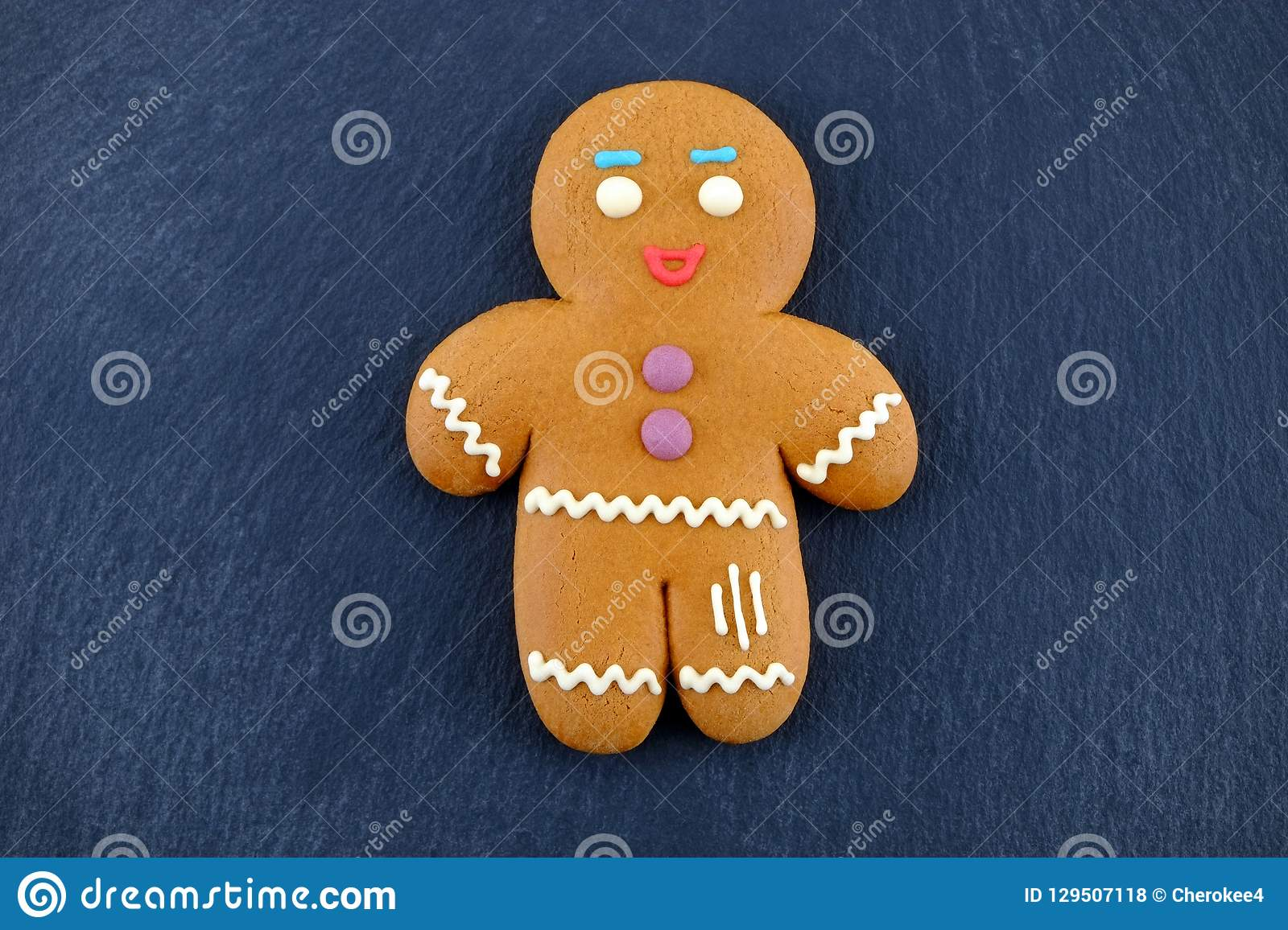 Gingerbread Man on dark background. Christmas or New Year composition