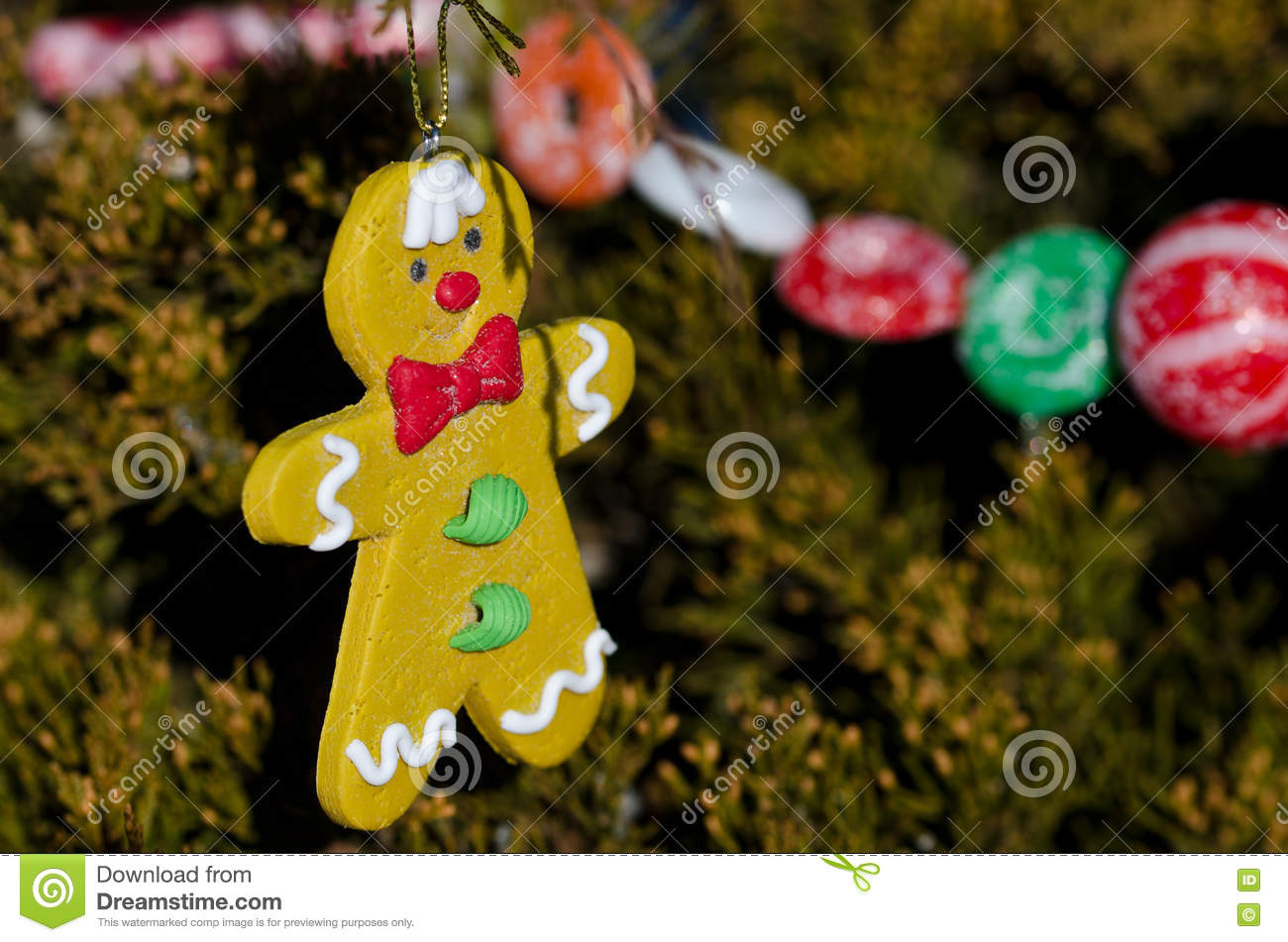 gingerbread man decoration on an outdoor christmas tree - Gingerbread Outdoor Christmas Decorations
