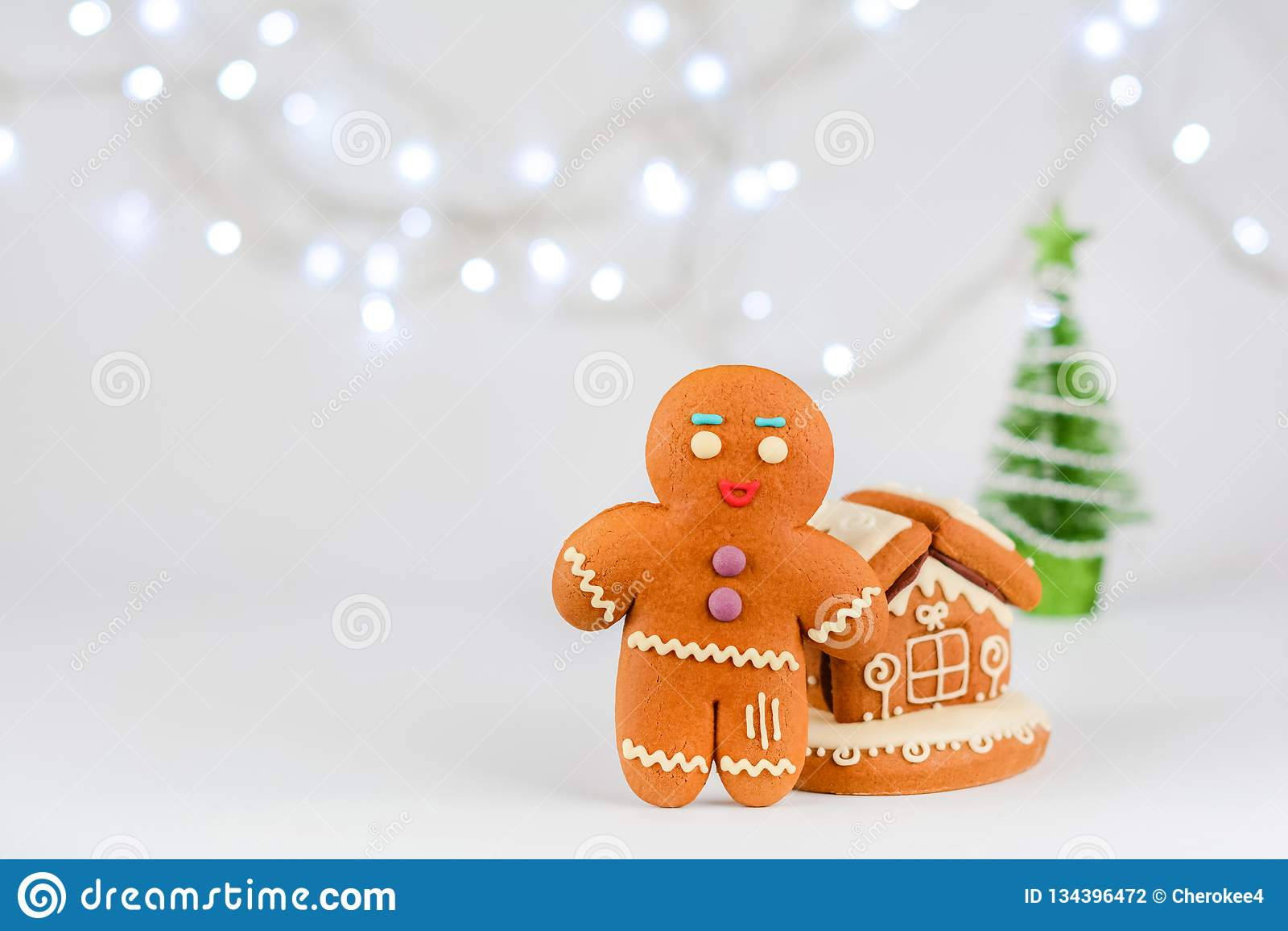 Gingerbread man near the house. Christmas food decoration.