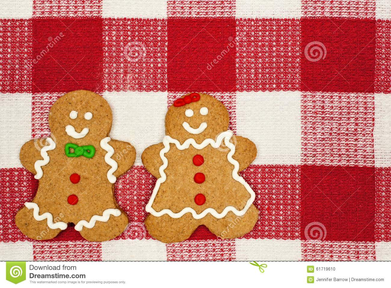Gingerbread people on a red and white checked cloth background