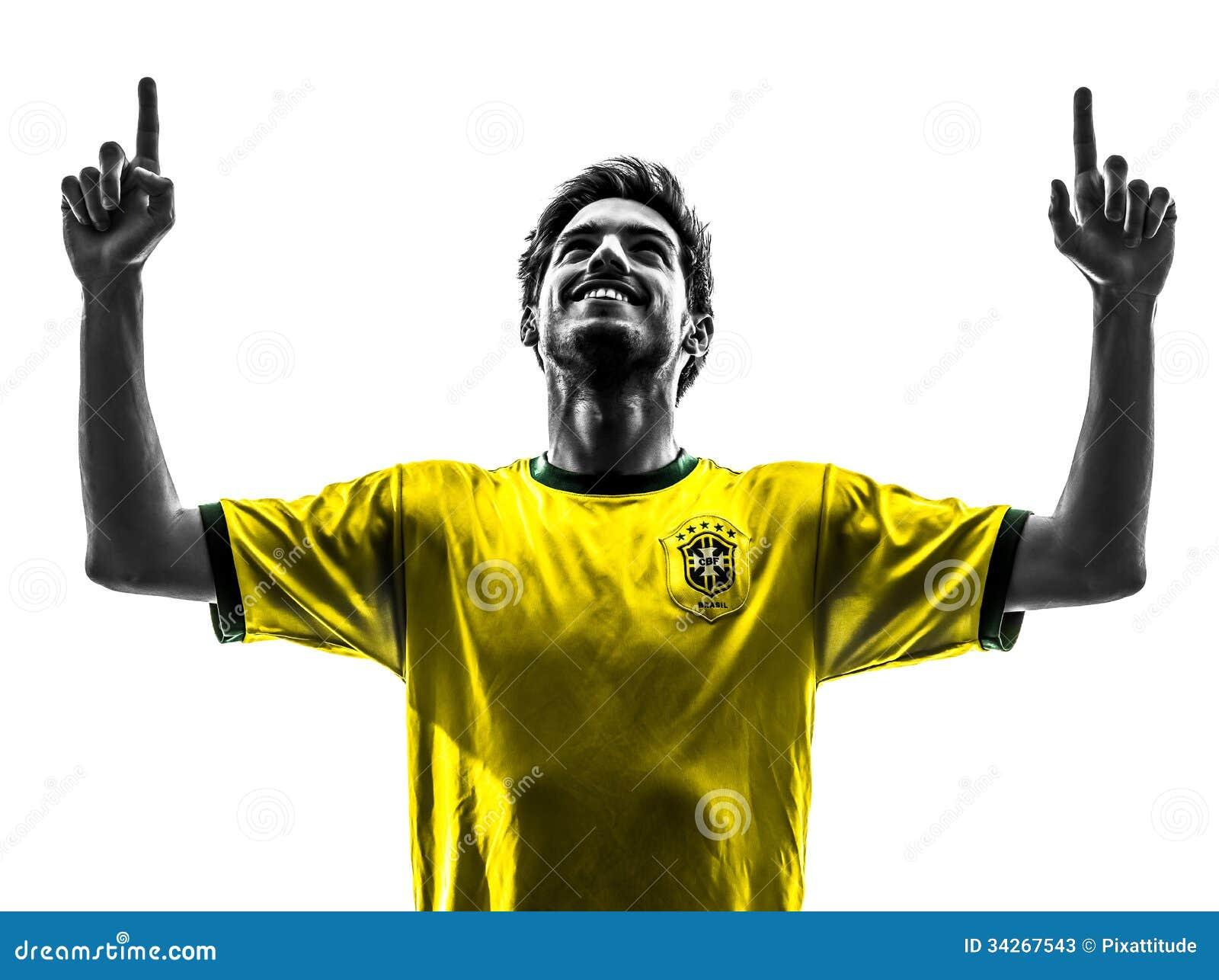 Giovane silhoue dell uomo di gioia di felicità del giocatore di football americano brasiliano di calcio