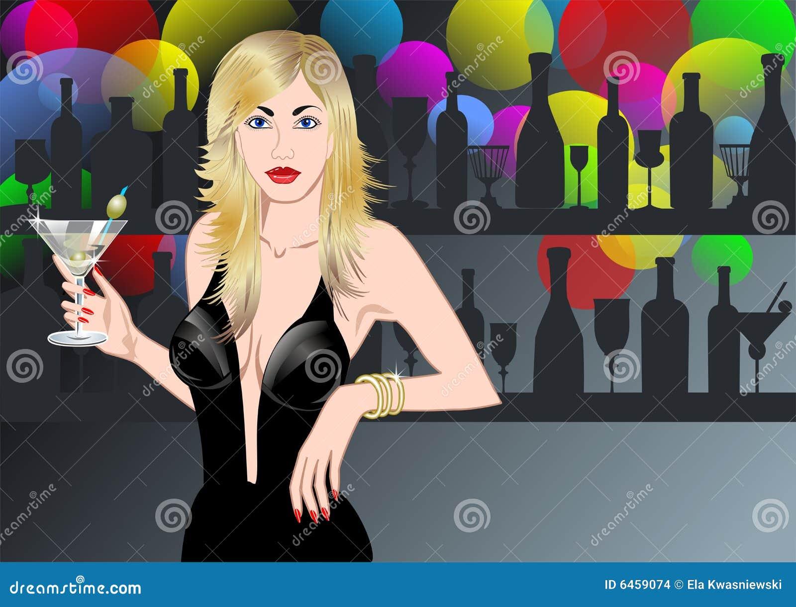 Giovani donne con il vetro del martini.