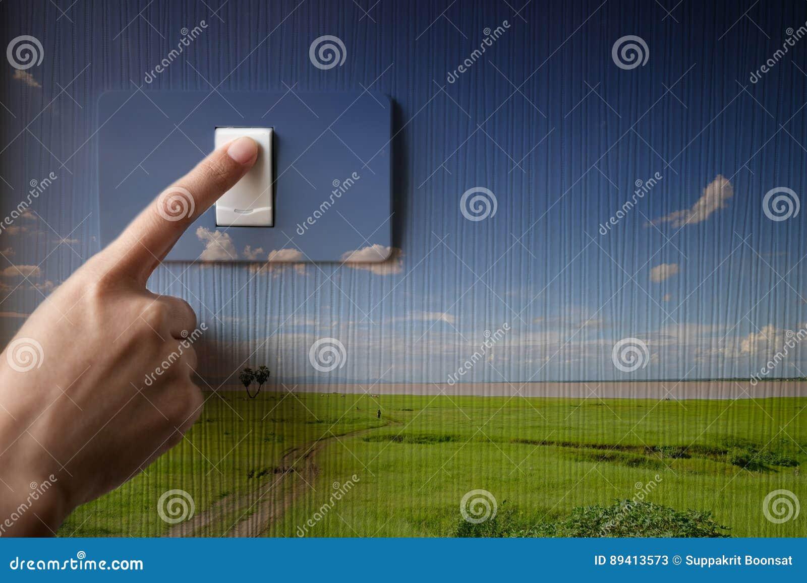 Girando de ligar/desligar no interruptor da luz, conceito de salvamento da energia