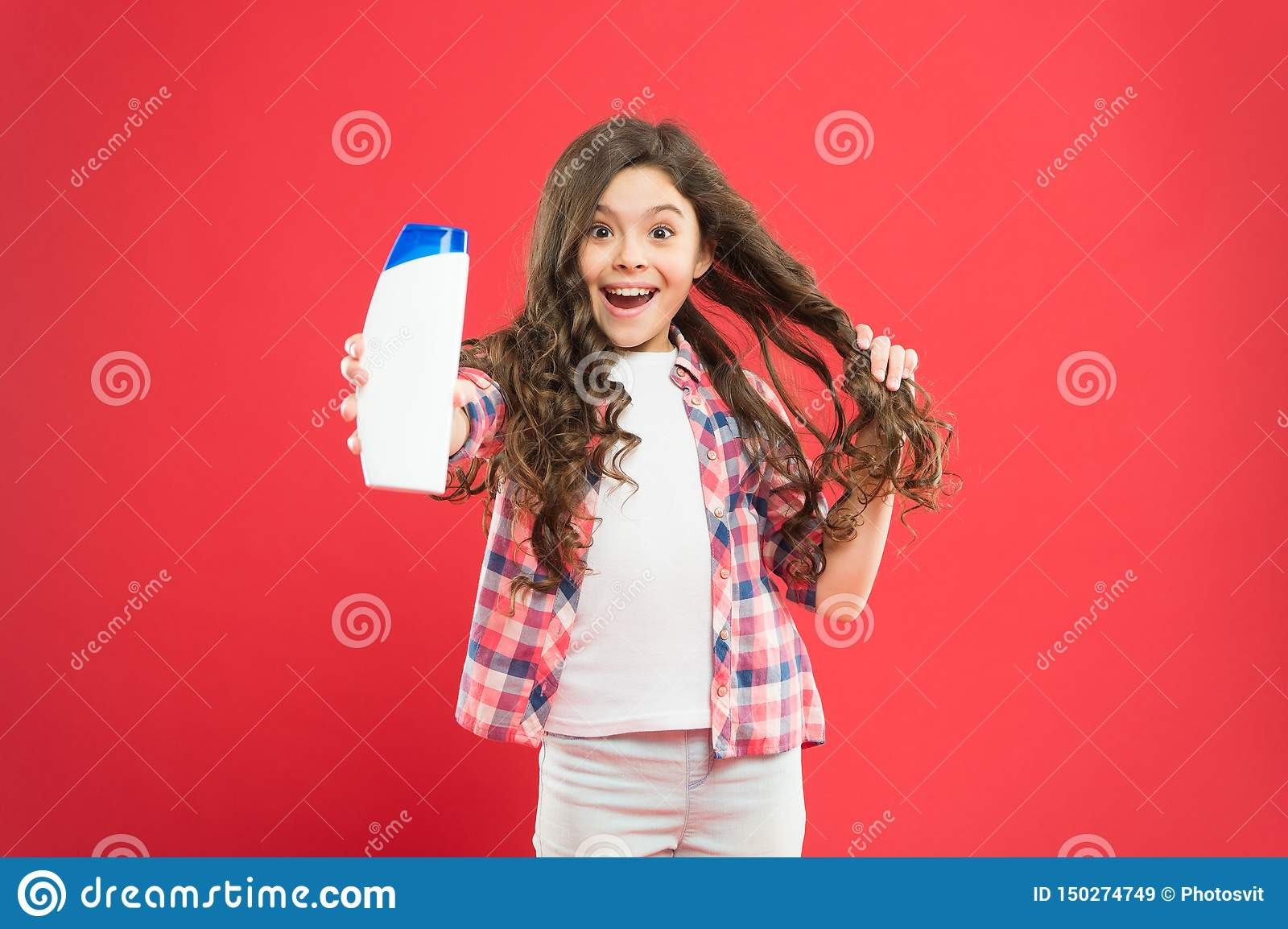 Girl active kid with long hair. Dry shampoo. Easy tips making hairstyle for kids. Strong and healthy hair concept. Long