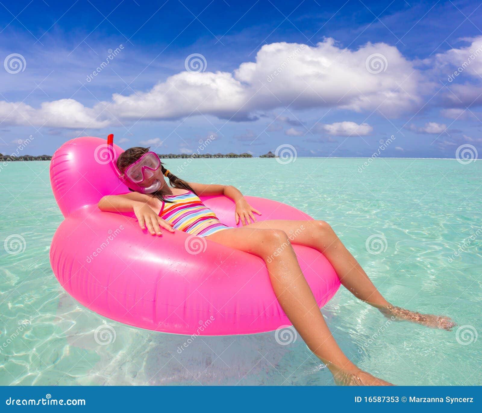Girl On Air Mattress In Sea Stock Photos Image 16587353
