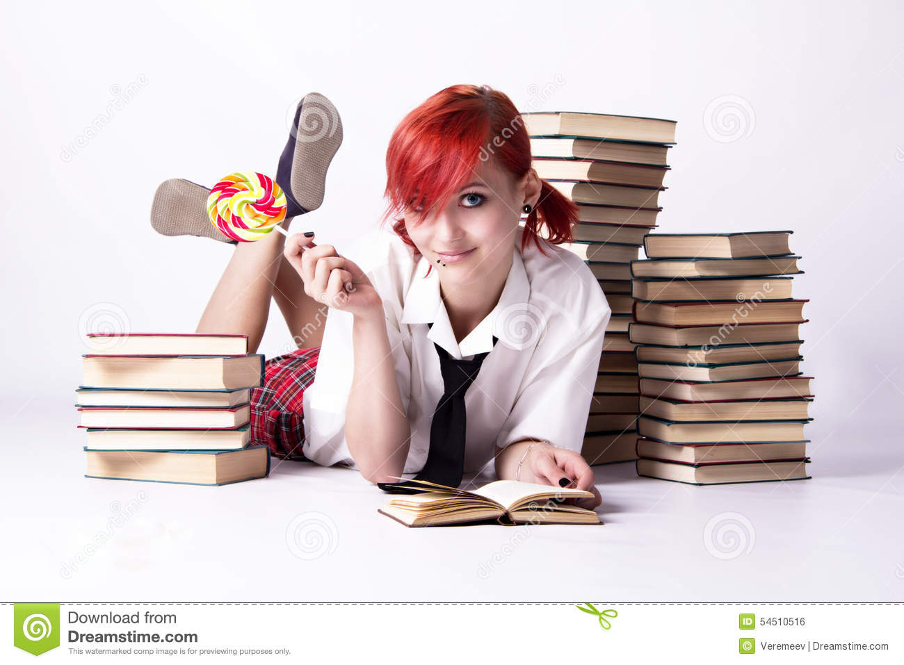 The girl in anime style with candy and books