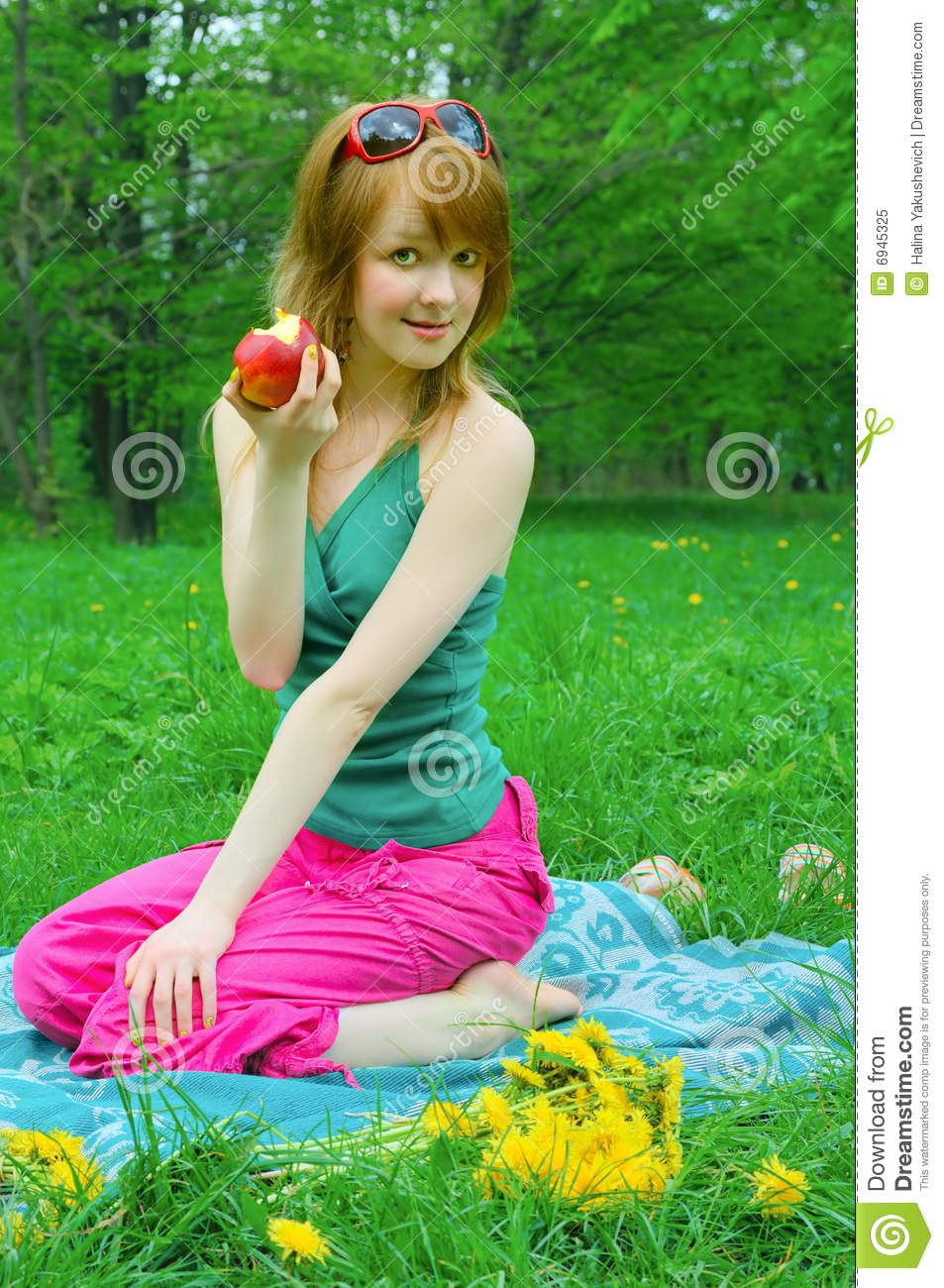 Girl with apple on coverlet