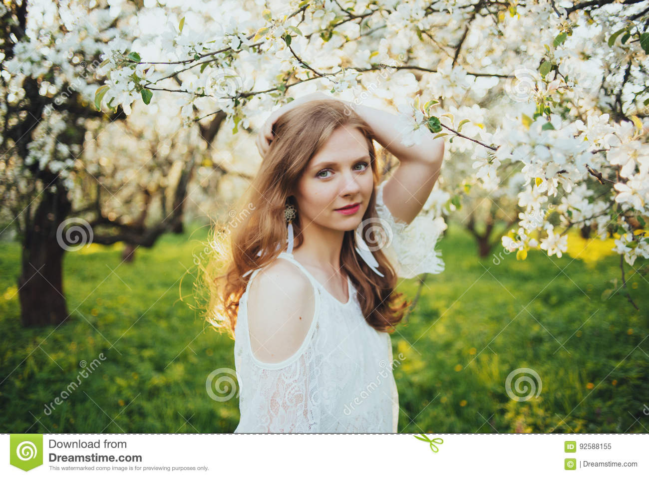 A girl in an apple orchard