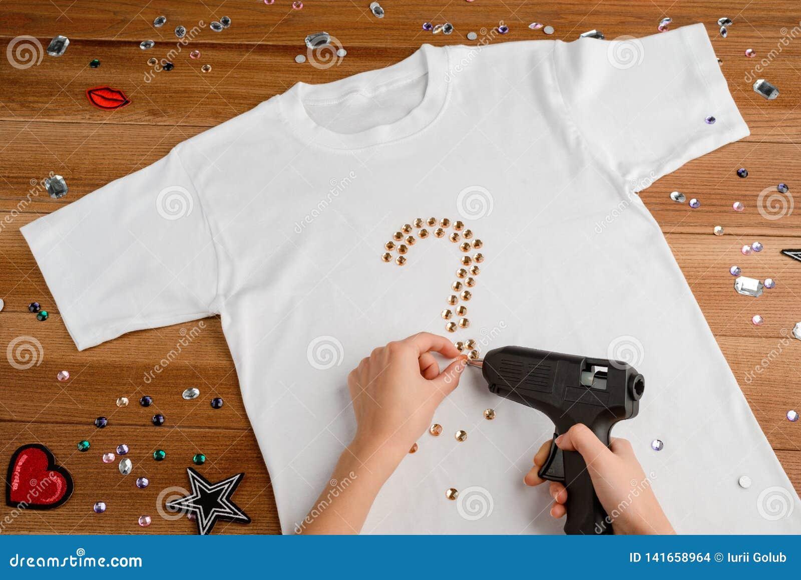 Girl Applying Rhinestones To T-shirt Stock Photo - Image of blank