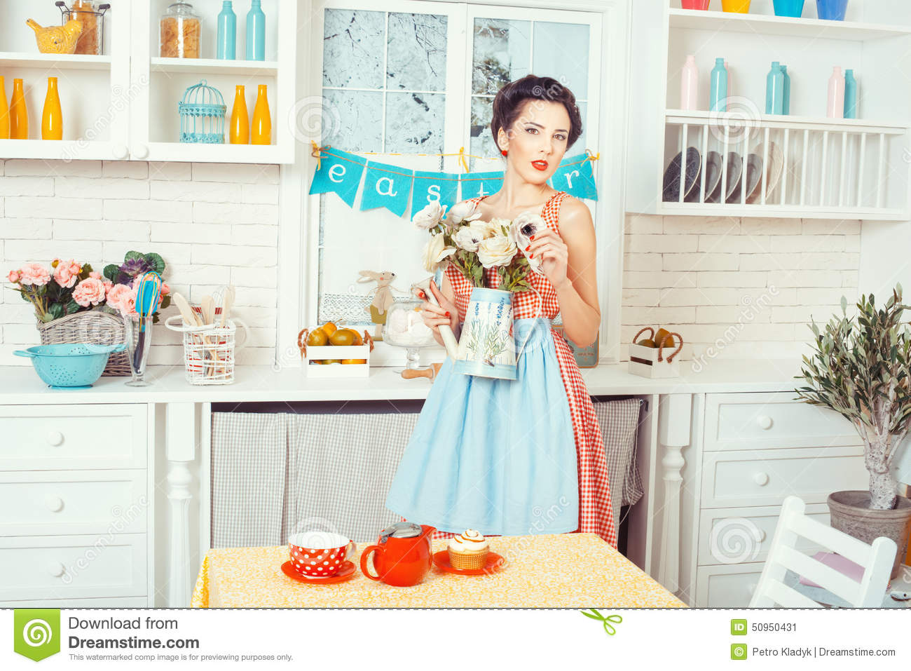 Girl apron with flowers in the kitchen stock photo for Kitchen pin