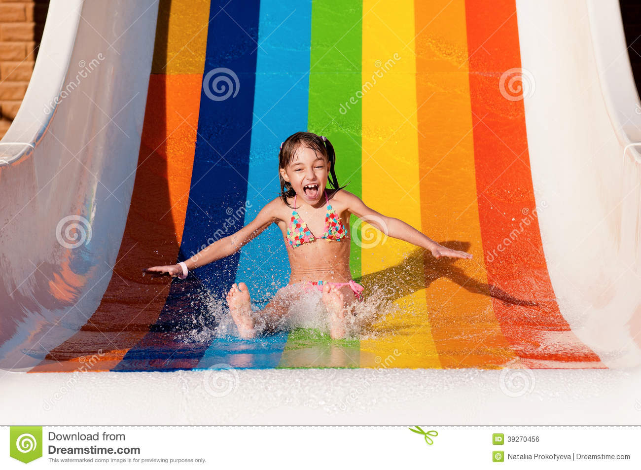Wonderful Young Girl Going Down A Waterslide On Her Tummy
