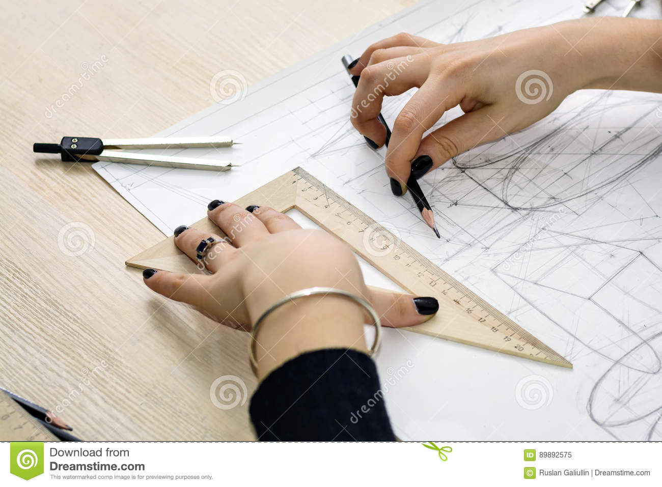 girl architect draws a plan design geometric shapes by pencil on