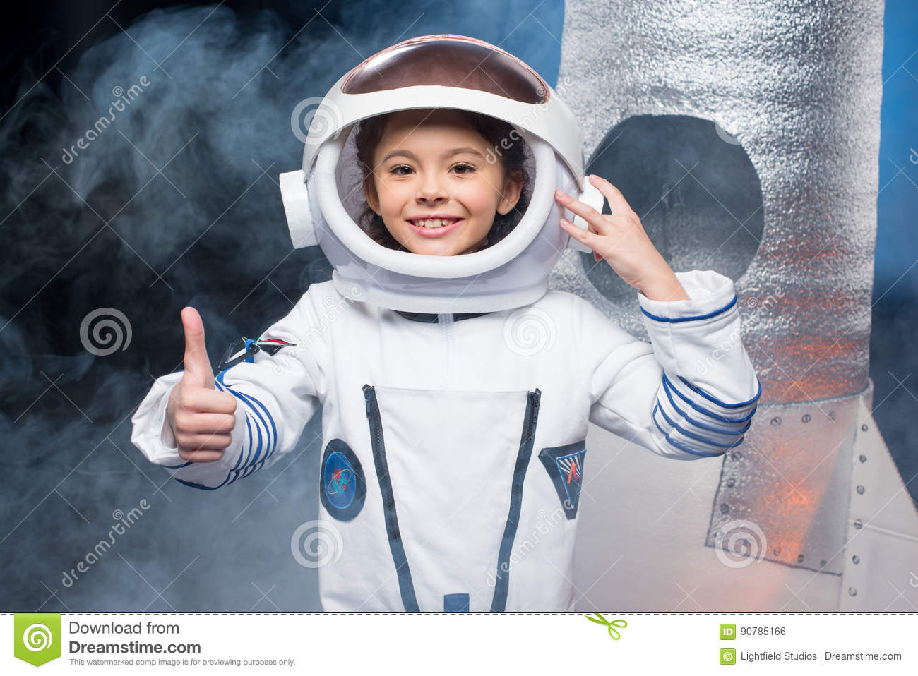 https://thumbs.dreamstime.com/z/girl-astronaut-costume-cute-little-showing-thumb-up-smiling-camera-90785166.jpg