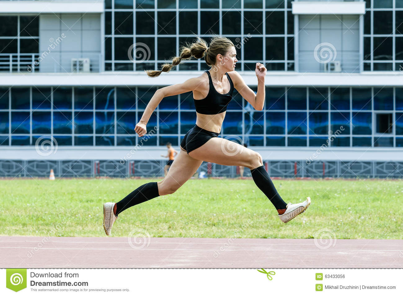 Girl athlete execution of triple jump