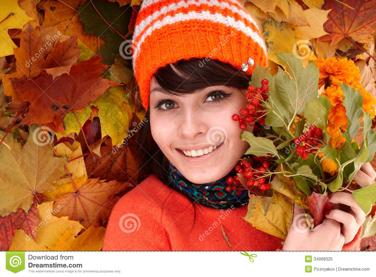 Girl in autumn orange leaves.