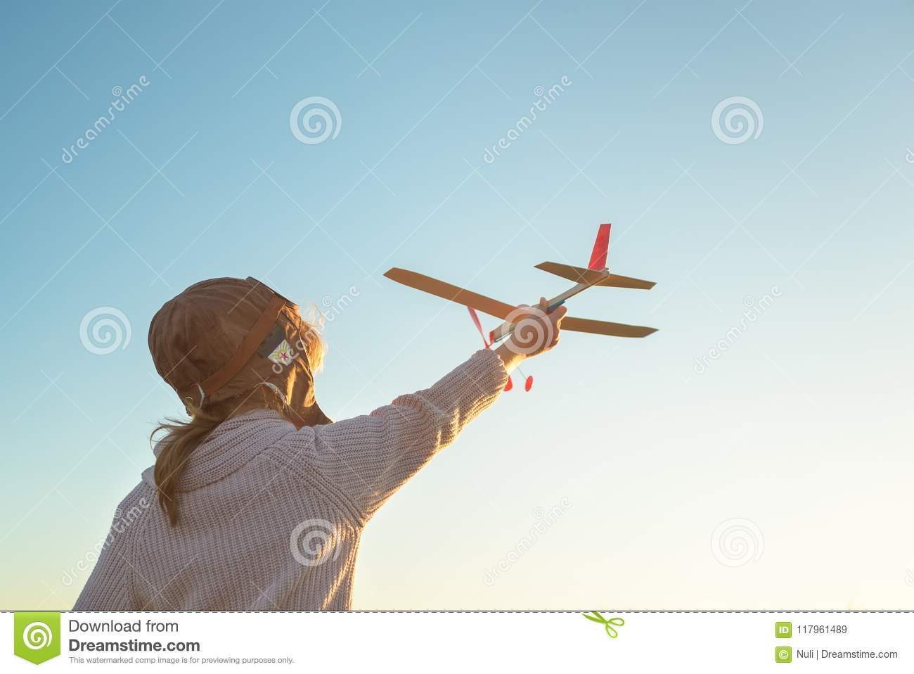 9df9097b921 Girl In Aviator Hat Playing Pilot With Toy Plane Outside Stock Image ...