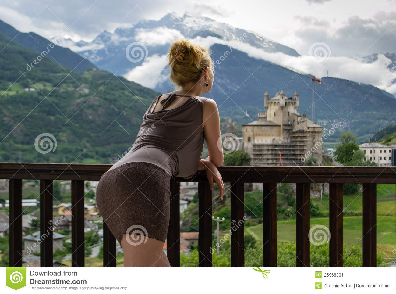 beautiful girl resting on the balcony of the hotel watching a ...