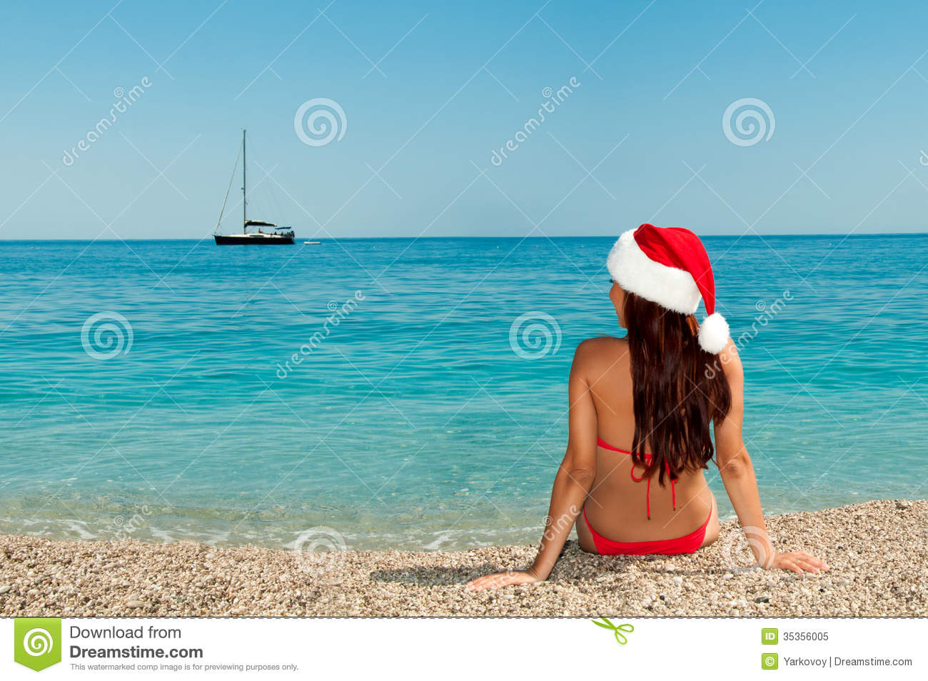 Girl On The Beach In A Christmas Hat. Royalty Free Stock Photo ...
