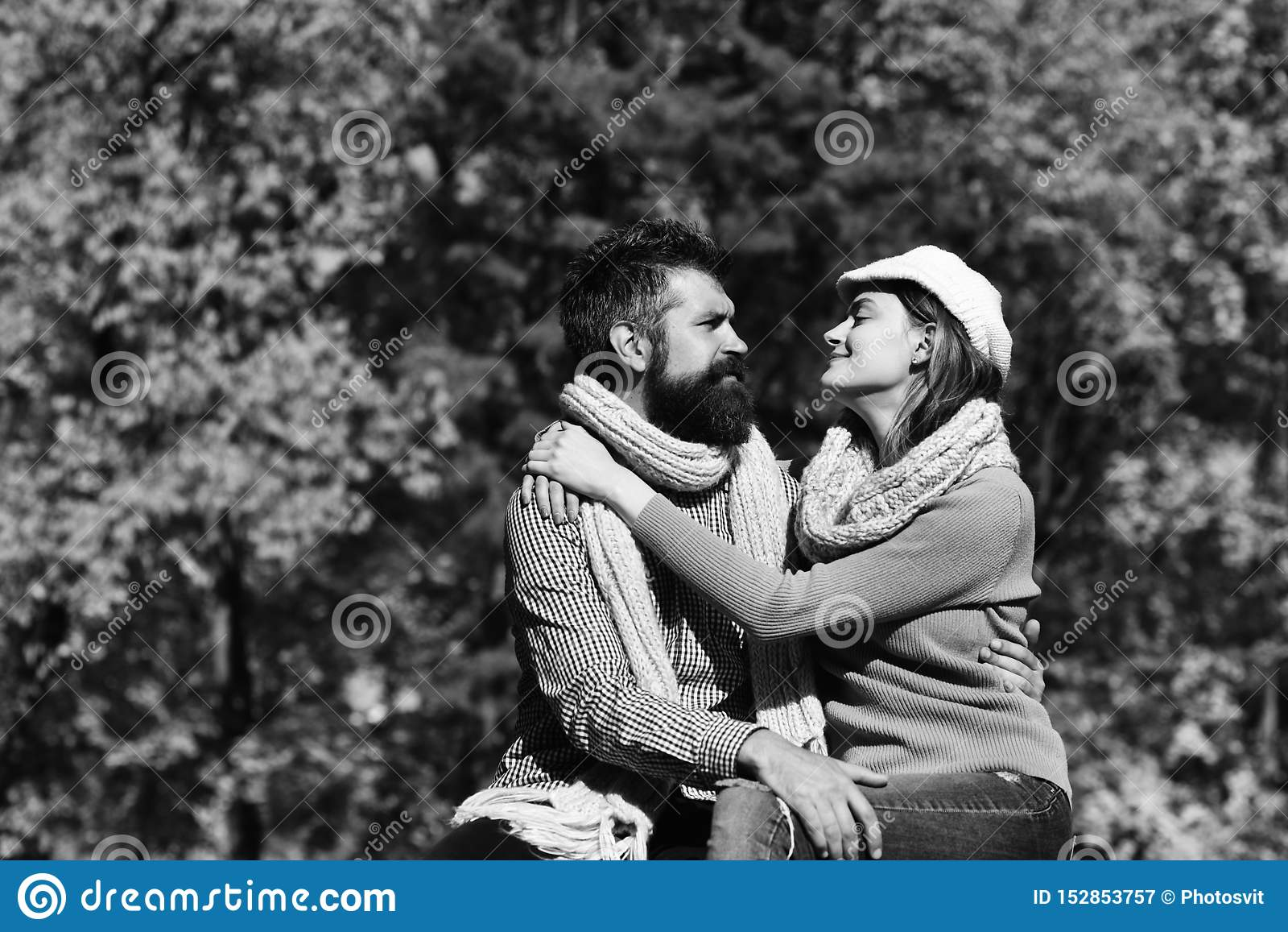 Girl and bearded guy or happy lovers on date hug