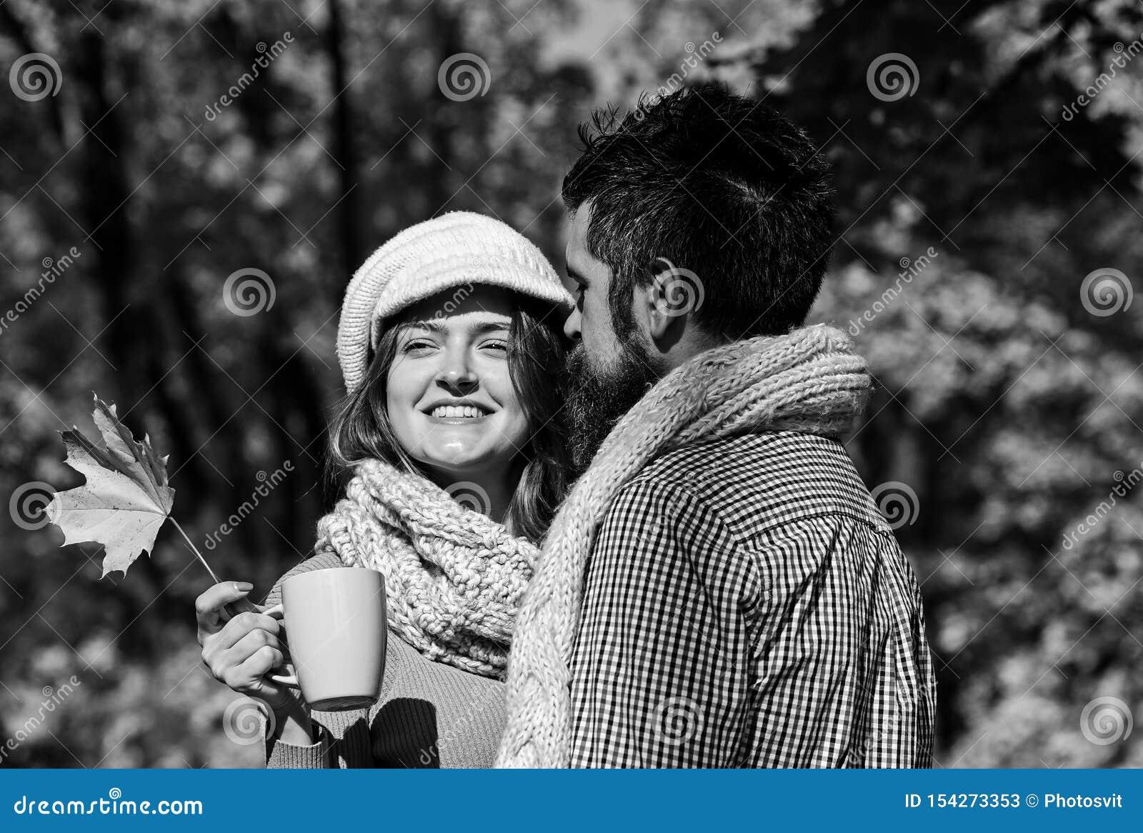 Girl and bearded guy or happy lovers on date hug