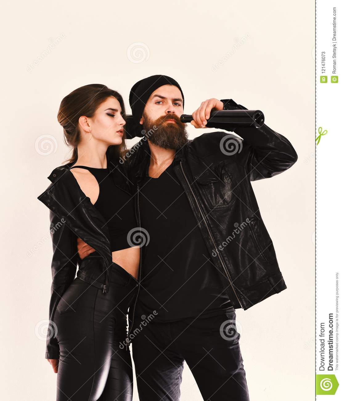 fdfe3d3ef Girl And Bearded Man In Black Leather Jacket And Hat Stock Image ...