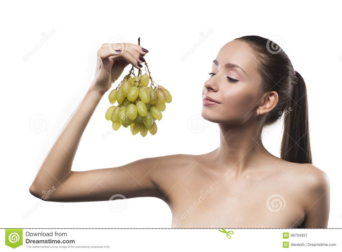 Girl Beauty Portrait With A Green Grapes Isolated On A White