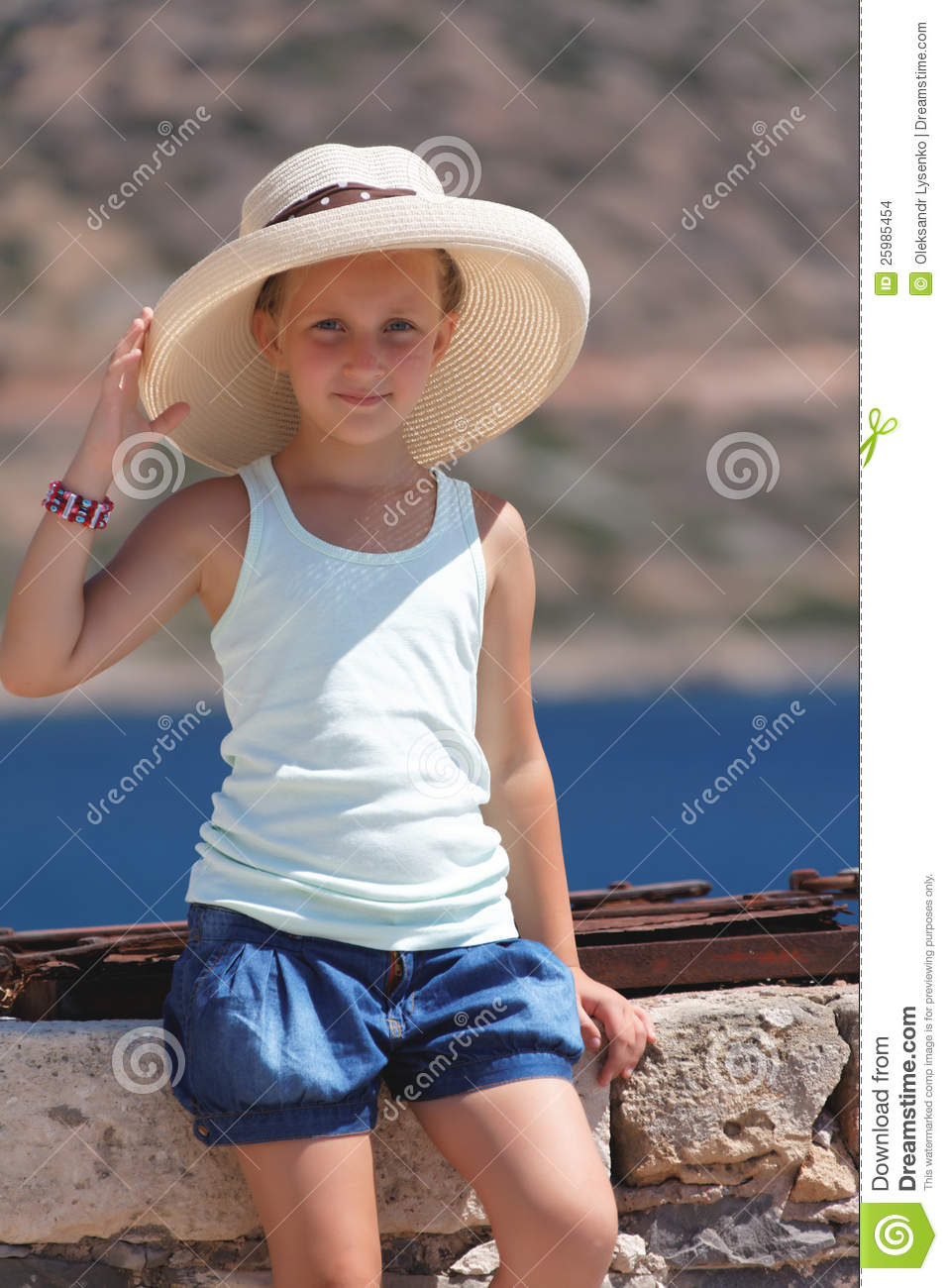 Girl In A Big Hat Stock Images