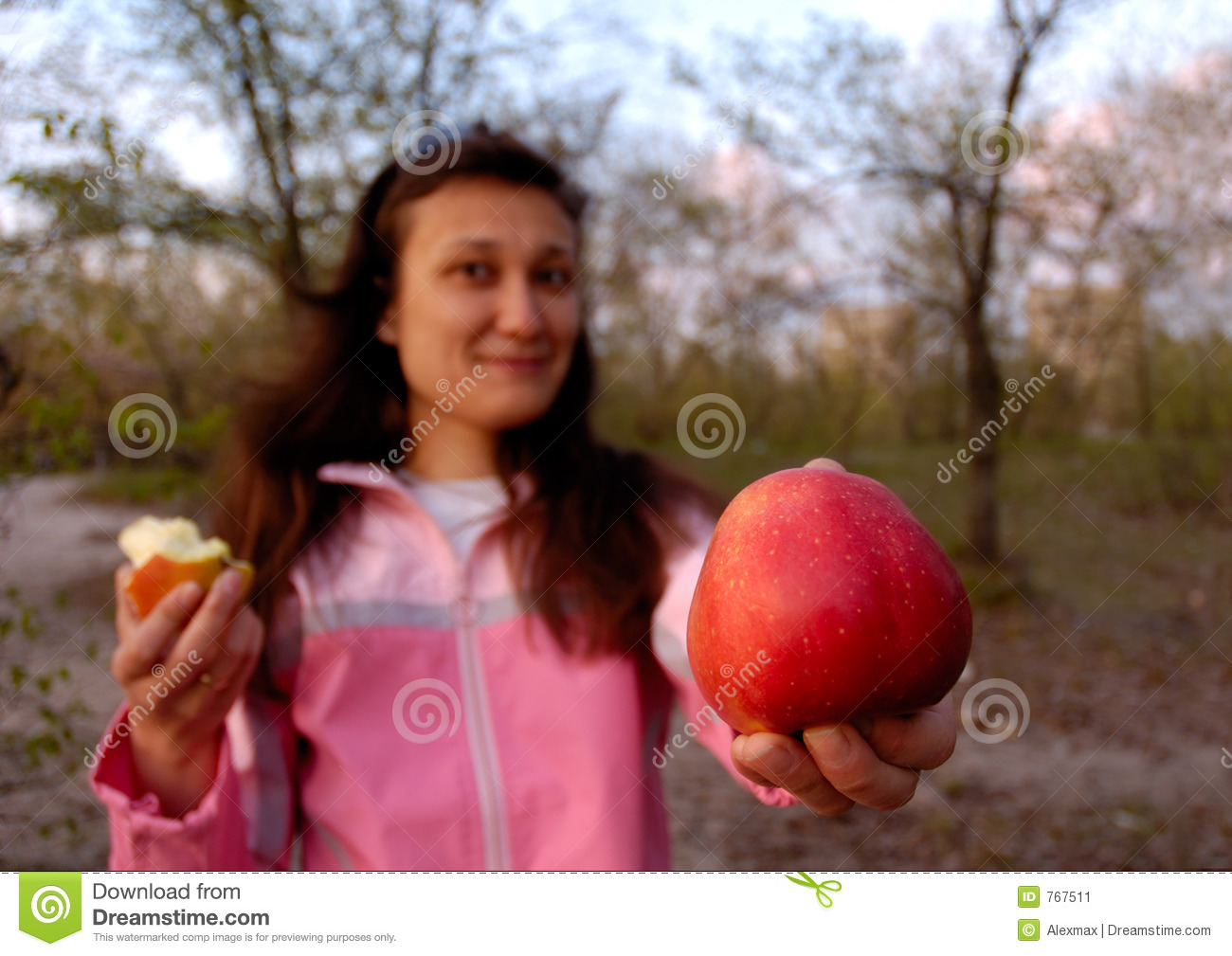 Girl with big red apple in her hand