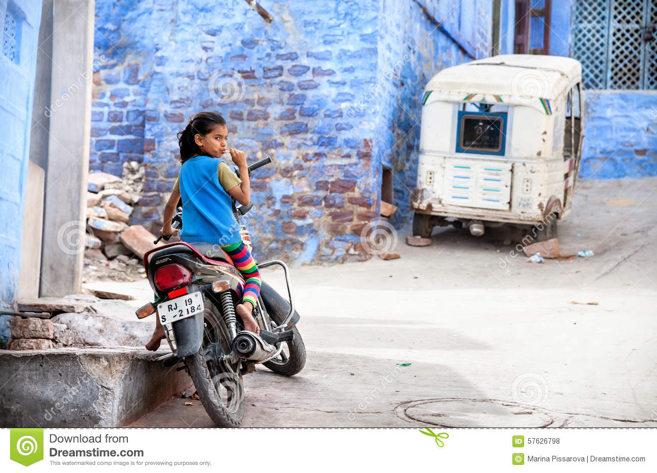 Girl on the bike in Blue city